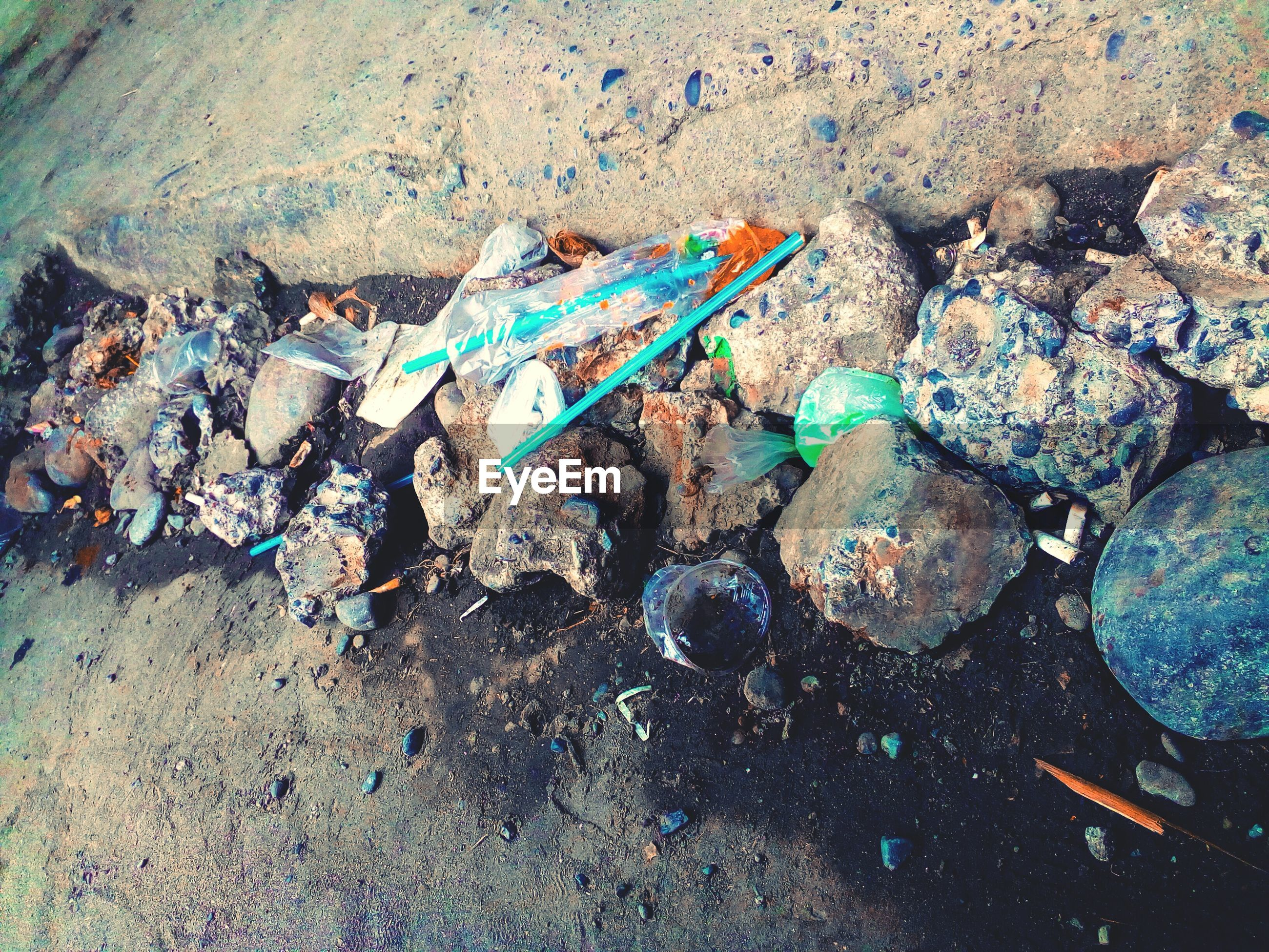 High angle view of garbage on rocks at beach