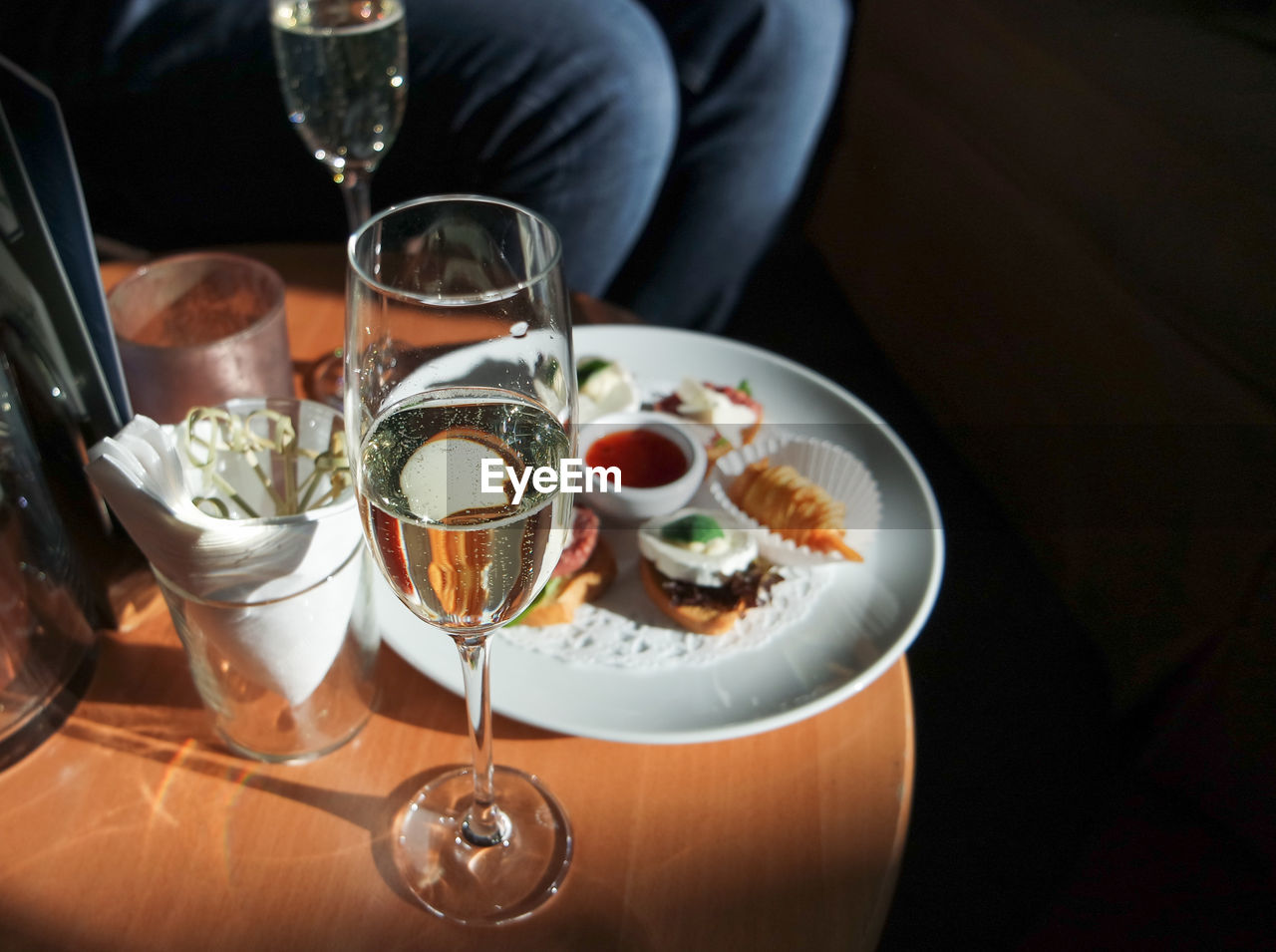 food and drink, drink, refreshment, table, food, alcohol, glass, freshness, indoors, wine, ready-to-eat, plate, wineglass, household equipment, serving size, high angle view, midsection, drinking glass, glass - material, one person