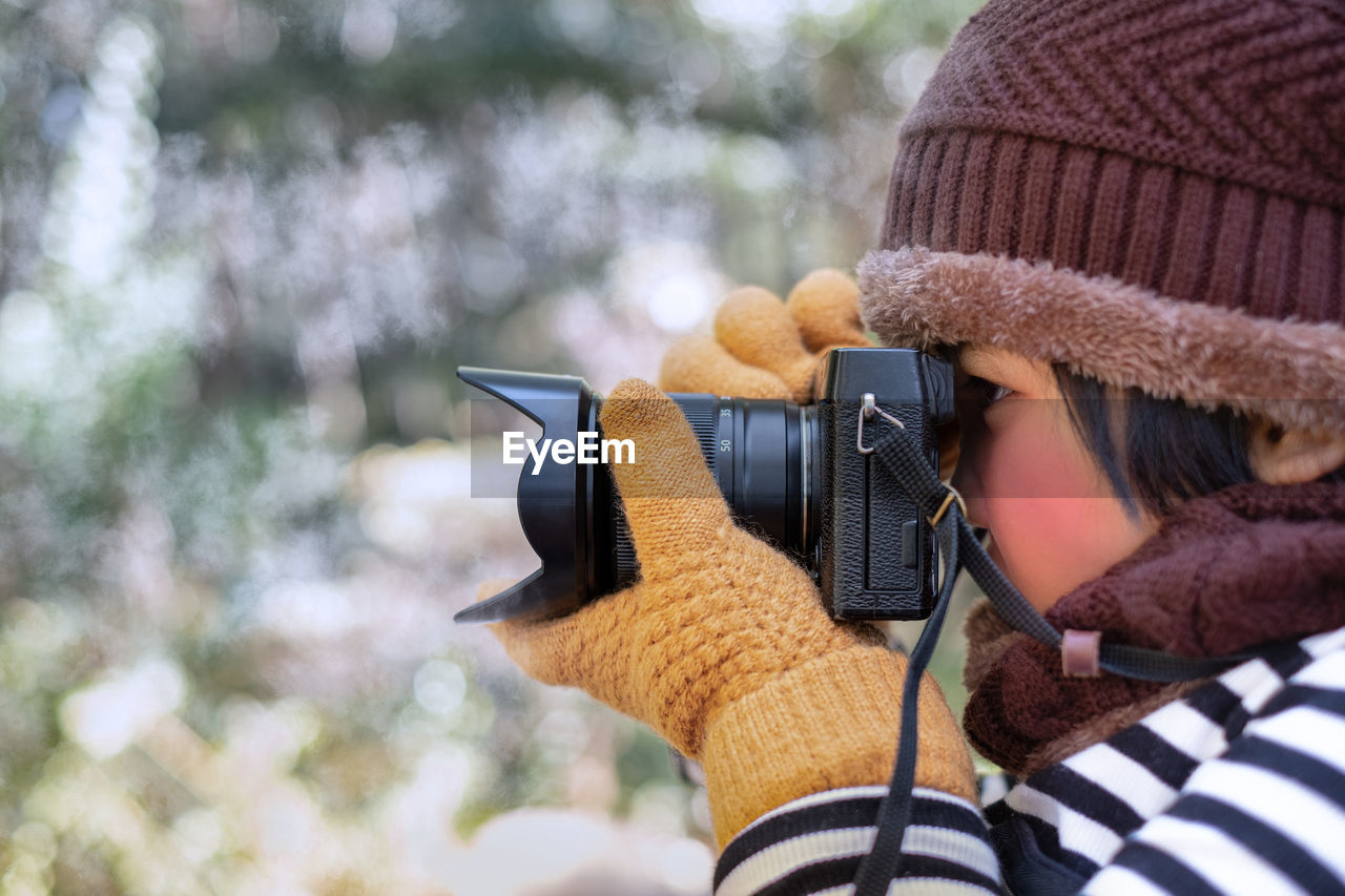 Portrait of little girl photographing in snow