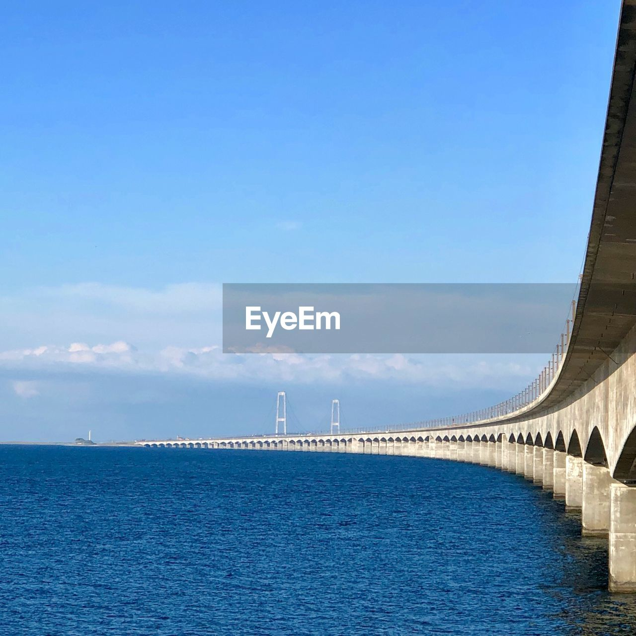 sky, water, built structure, architecture, day, renewable energy, nature, sea, fuel and power generation, no people, scenics - nature, environmental conservation, alternative energy, turbine, wind turbine, beauty in nature, environment, connection, blue, outdoors, sustainable resources