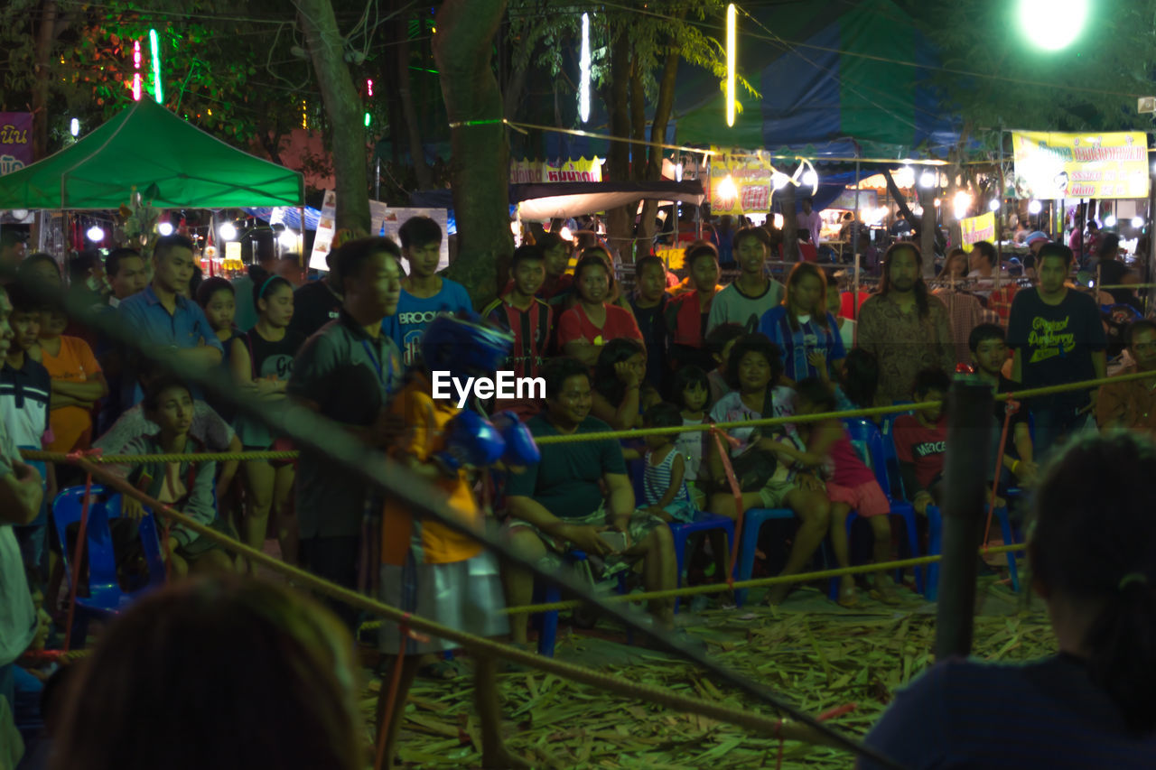 large group of people, real people, night, crowd, arts culture and entertainment, men, leisure activity, women, enjoyment, togetherness, event, performance, outdoors, illuminated, lifestyles, fun, celebration, music, spectator, audience, popular music concert, city, adult, people