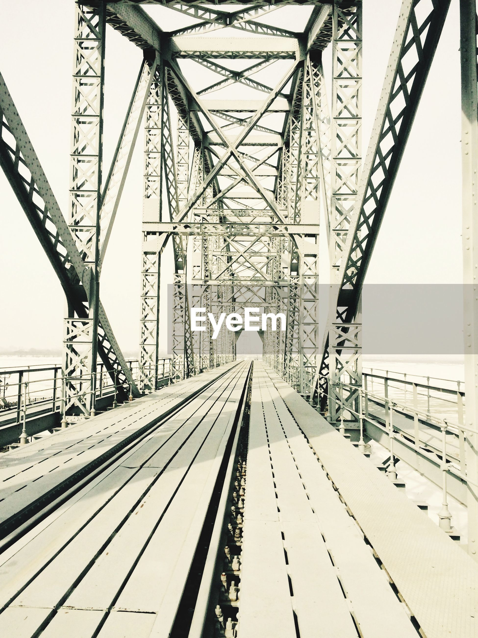 connection, engineering, diminishing perspective, bridge - man made structure, transportation, built structure, clear sky, the way forward, metal, snow, vanishing point, long, architecture, suspension bridge, cold temperature, winter, metallic, day, rail transportation, travel destinations
