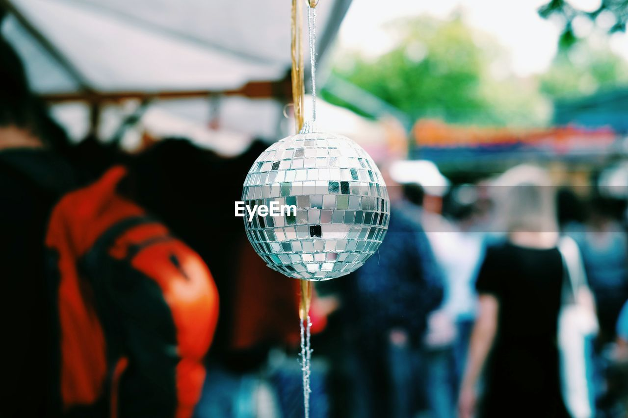 Close-Up Of Disco Ball Hanging At Market Stall