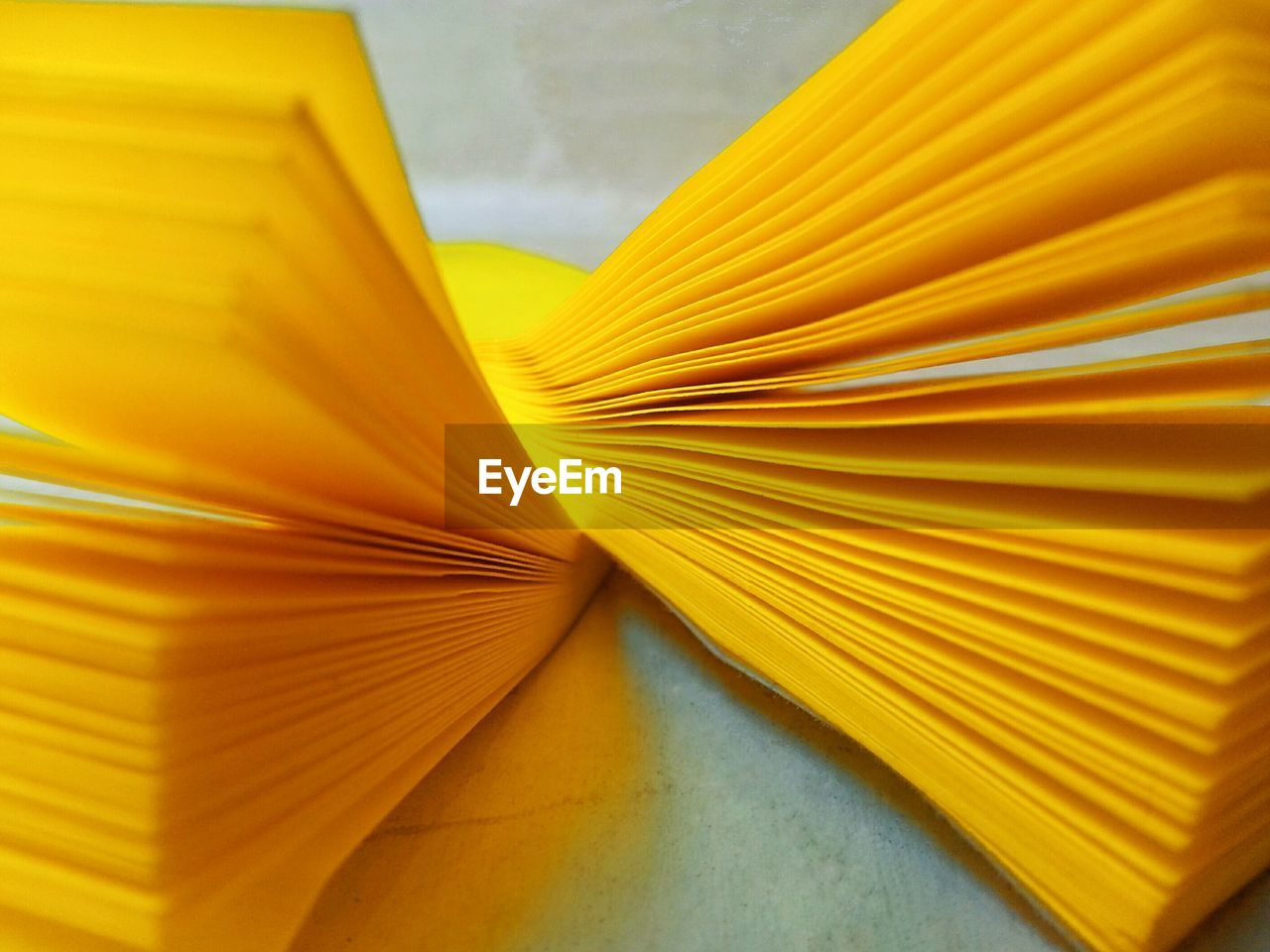 yellow, close-up, no people, paper, still life, indoors, pattern, table, selective focus, page, large group of objects, publication, backgrounds, full frame, abstract, multi colored, spaghetti, high angle view, creativity, stack