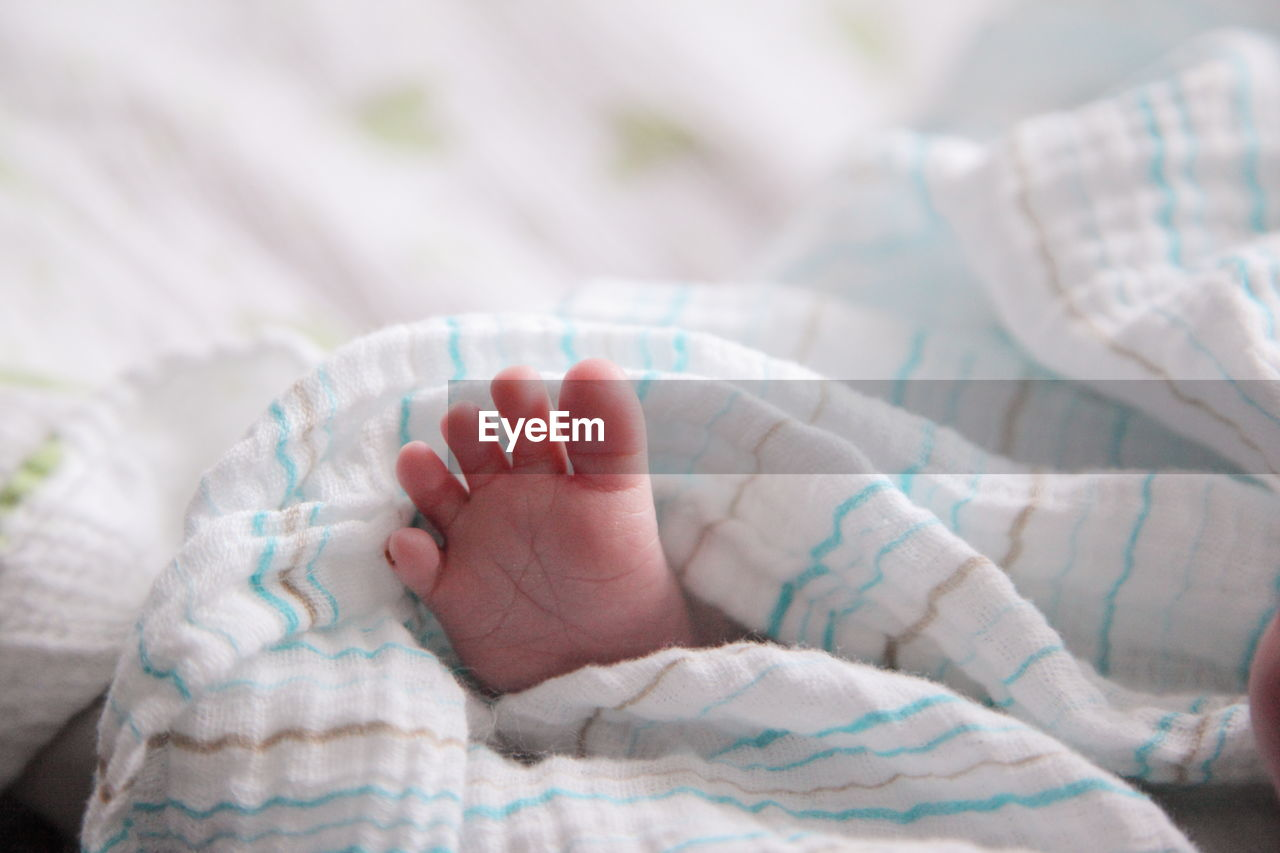 Foot Of Baby Sleeping In Bed