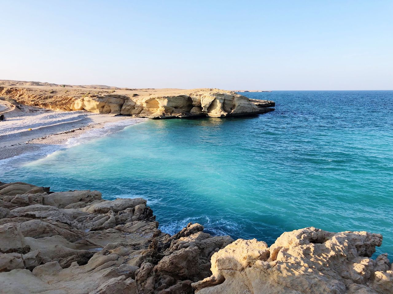 sea, water, rock, rock - object, beauty in nature, scenics - nature, sky, solid, tranquil scene, tranquility, land, rock formation, horizon, clear sky, idyllic, horizon over water, nature, beach, blue, no people, outdoors, rocky coastline, eroded, turquoise colored