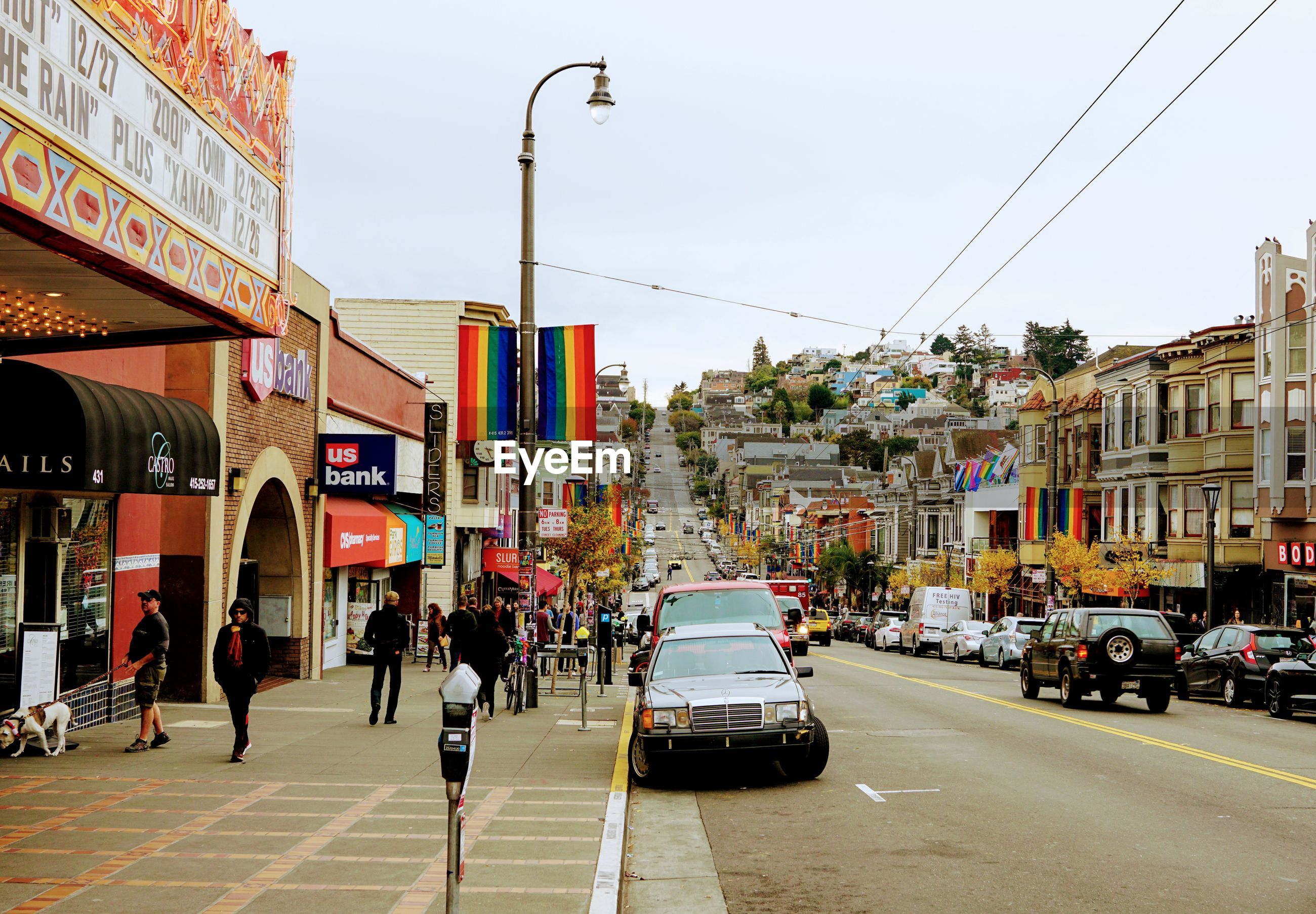 CARS ON CITY STREET AGAINST BUILDINGS