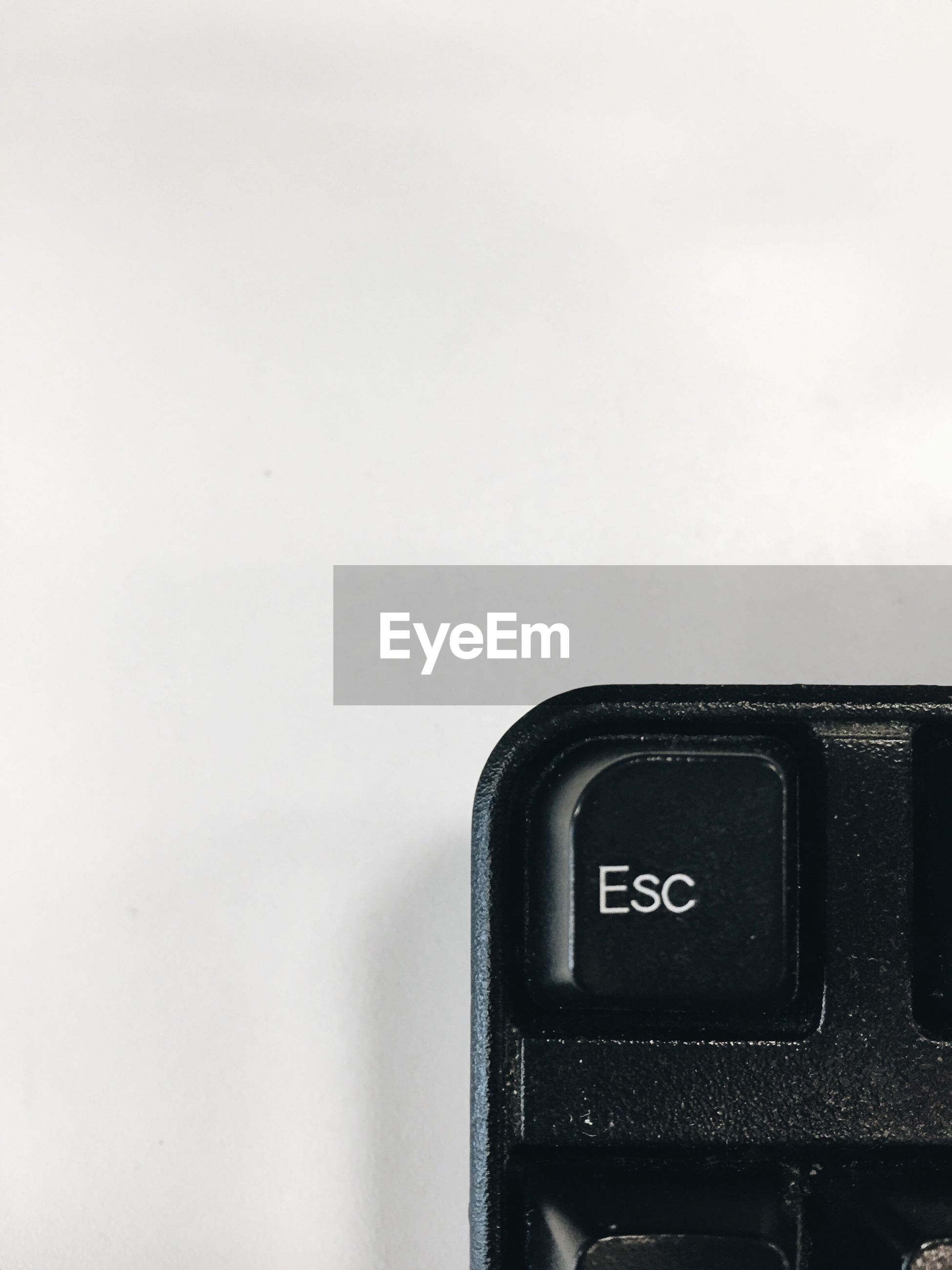 Cropped image of escape key over white background
