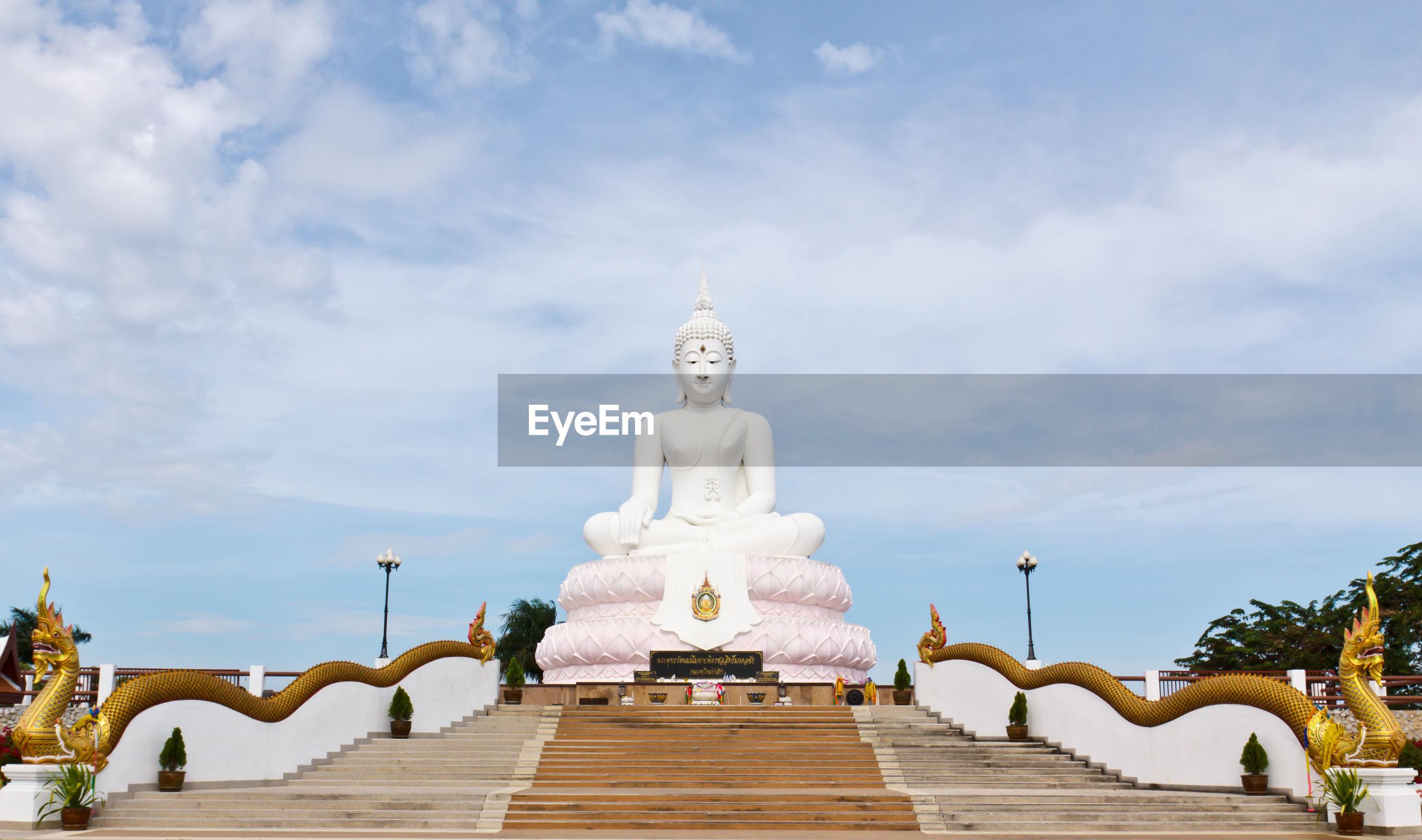 STATUE OF BUDDHA AGAINST SKY