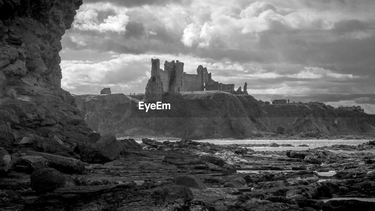 Tantallon Castle And Beach Against Cloudy Sky