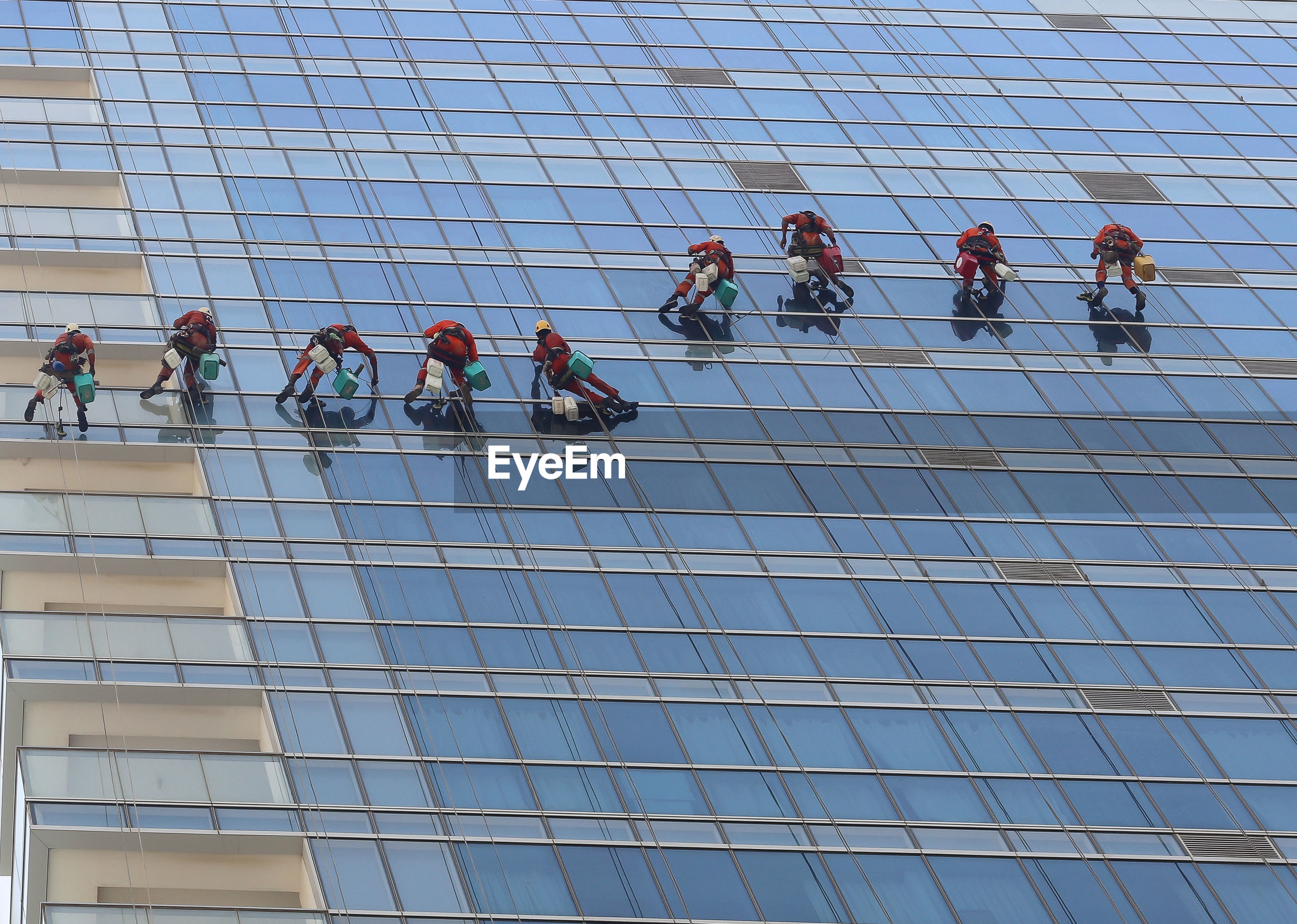 LOW ANGLE VIEW OF PEOPLE WORKING AT WINDOW