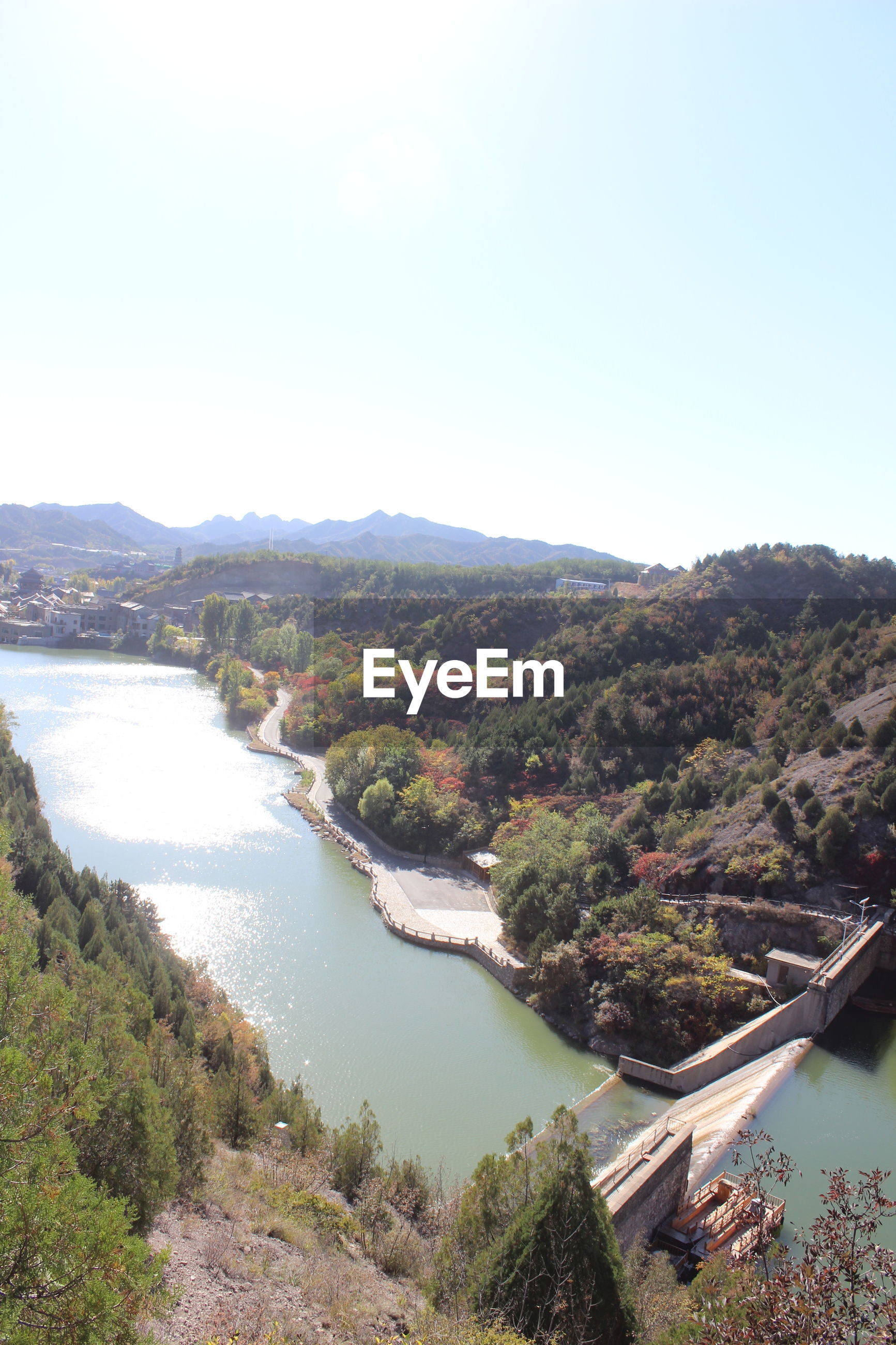 HIGH ANGLE VIEW OF RIVER AMIDST GREEN LANDSCAPE AGAINST CLEAR SKY