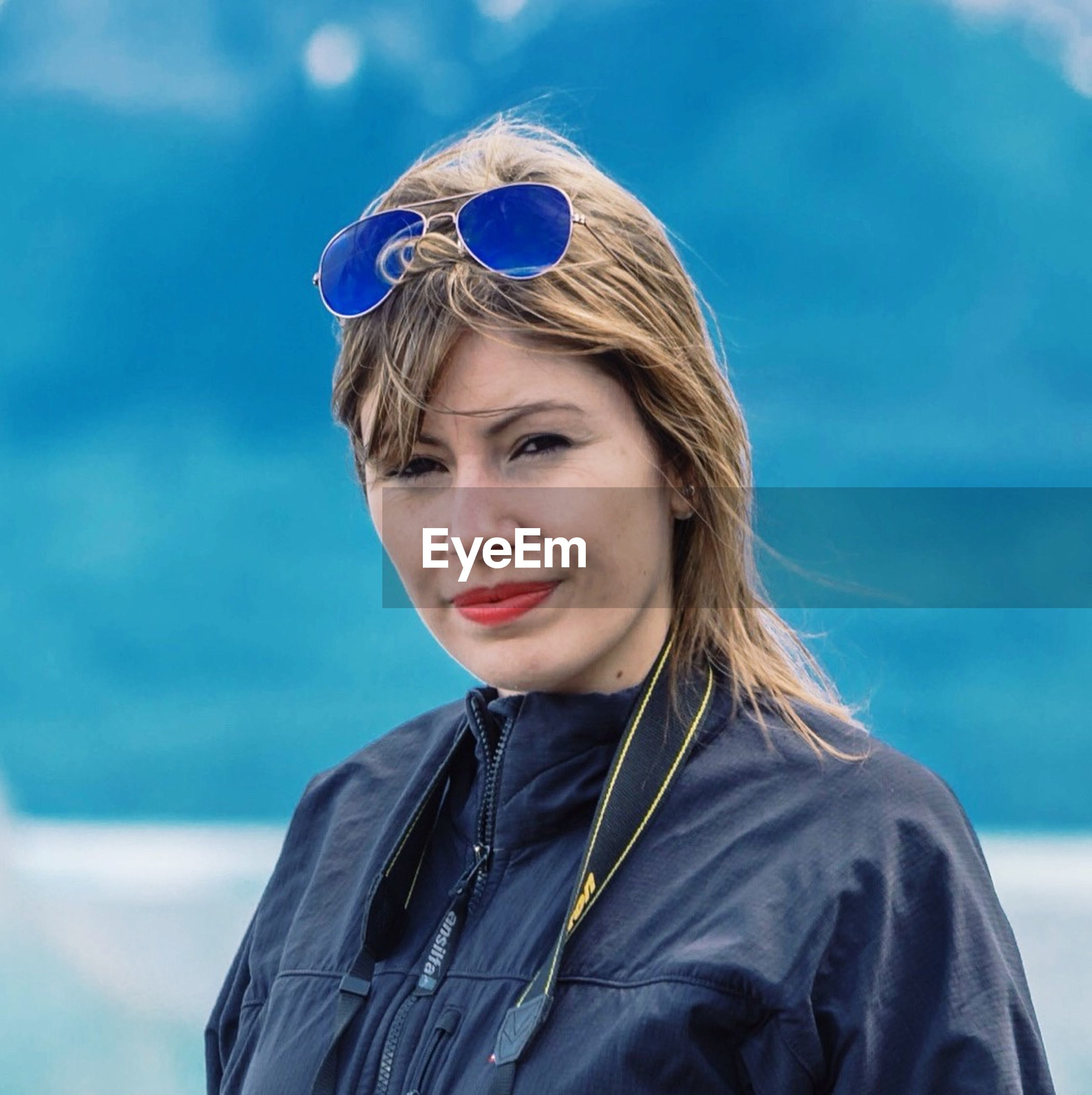 Portrait of beautiful woman wearing jacket outdoors