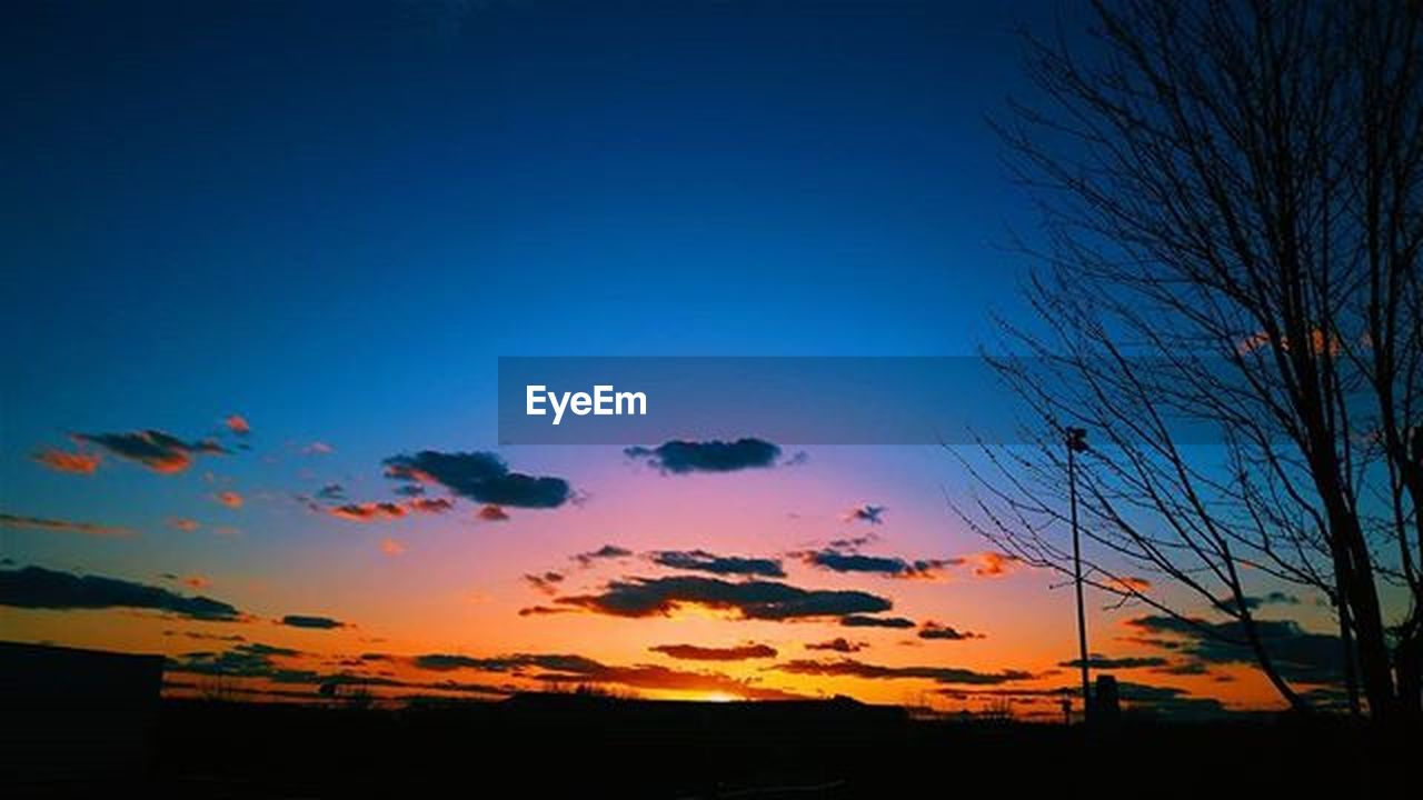 sunset, scenics, sky, silhouette, no people, outdoors, nature, tree, blue, cloud - sky, tranquil scene, tranquility, multi colored, beauty in nature, day