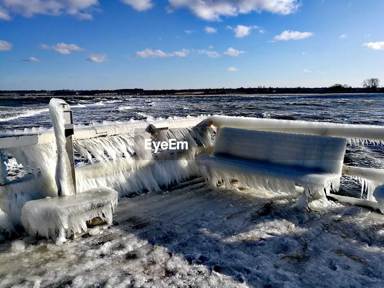 nature, water, cold temperature, beauty in nature, winter, sky, scenics, snow, day, outdoors, white color, tranquil scene, weather, cloud - sky, tranquility, frozen, ice, no people, motion, landscape, iceberg
