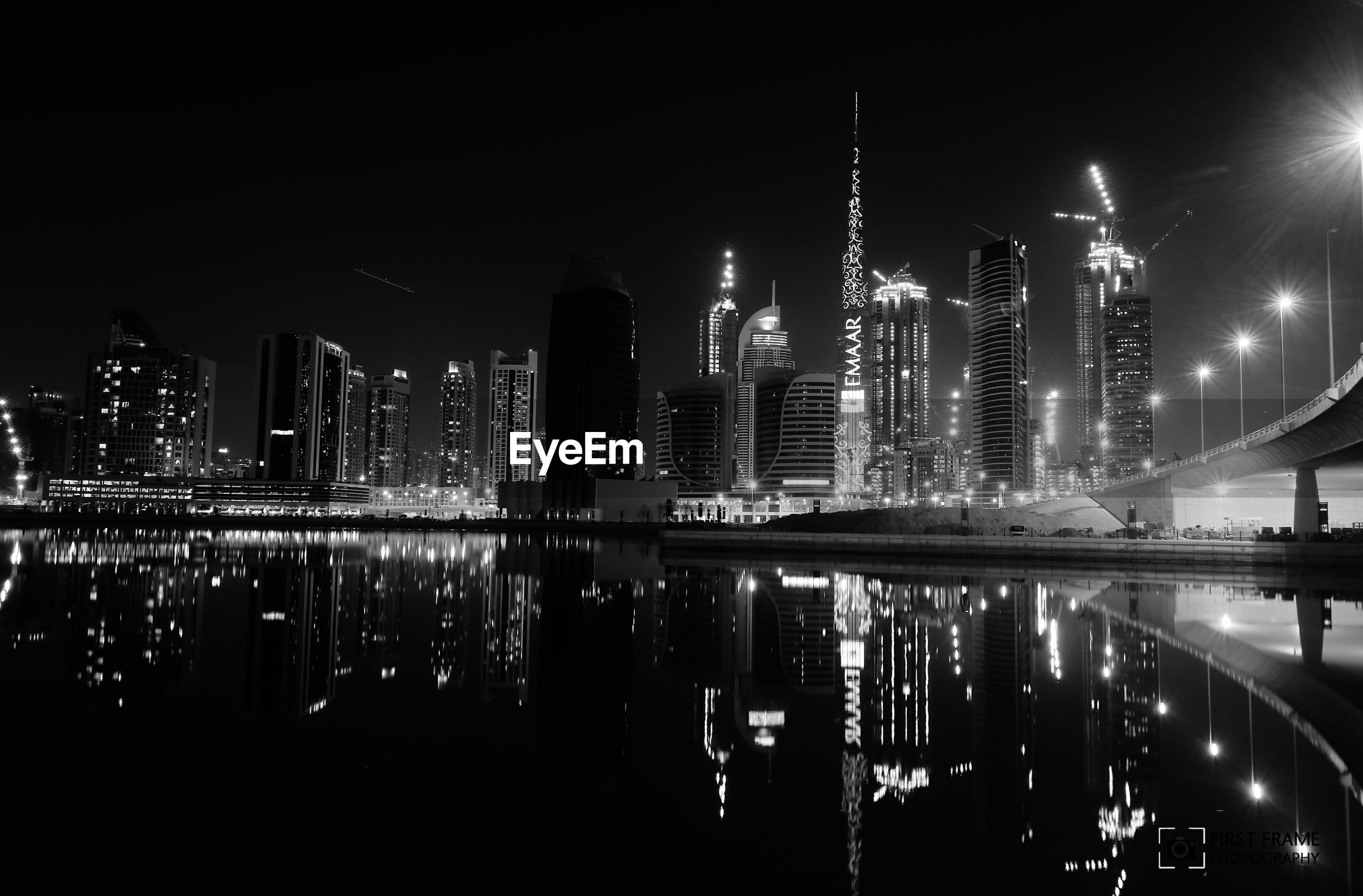 night, illuminated, skyscraper, city, architecture, building exterior, built structure, reflection, tall - high, modern, water, urban skyline, tower, cityscape, river, office building, financial district, travel destinations, waterfront, capital cities