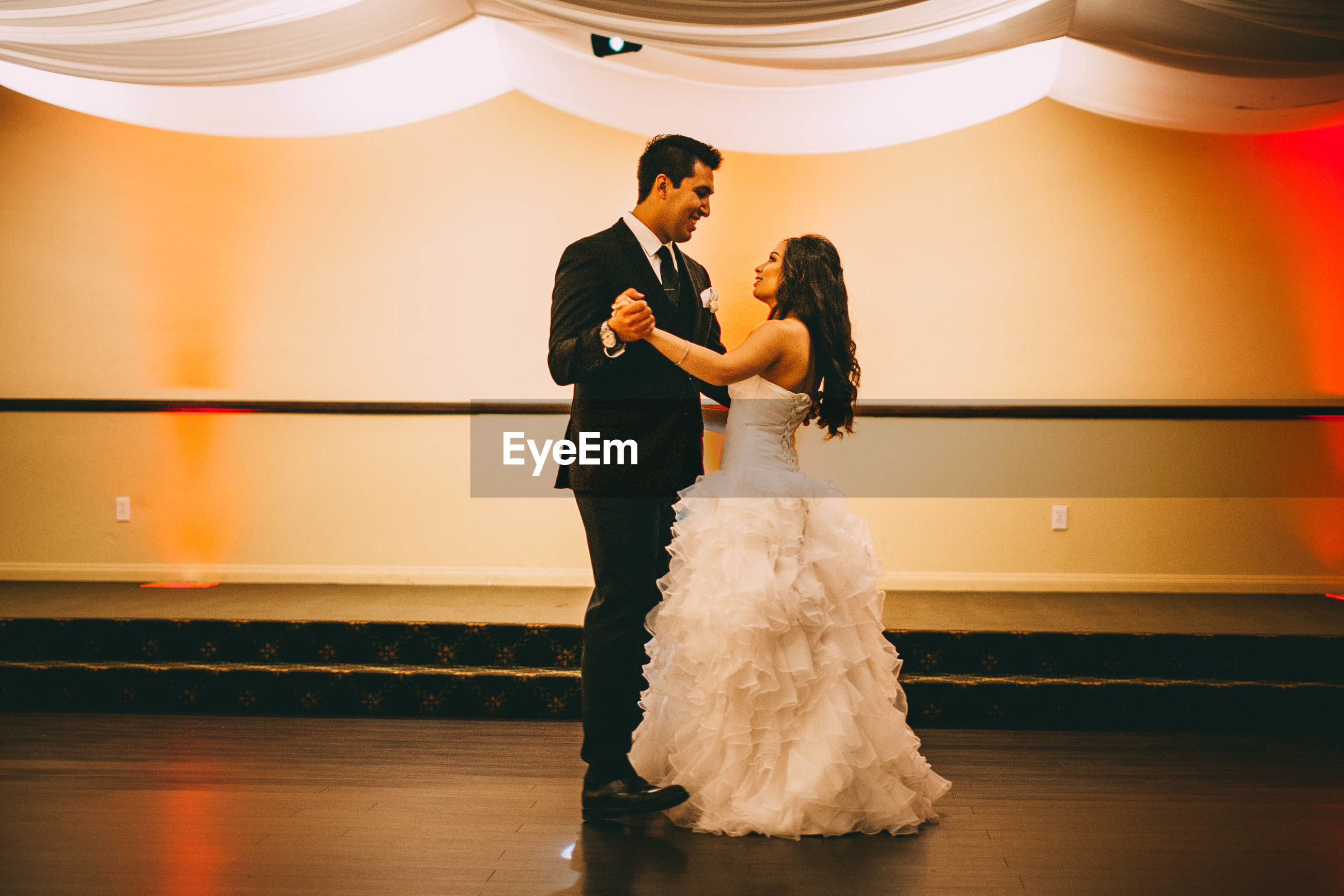 wedding, bride, love, wedding dress, bridegroom, togetherness, life events, celebration, real people, wife, men, women, groom, bonding, young women, husband, indoors, couple - relationship, young adult, young men, married, full length, bouquet, day, people