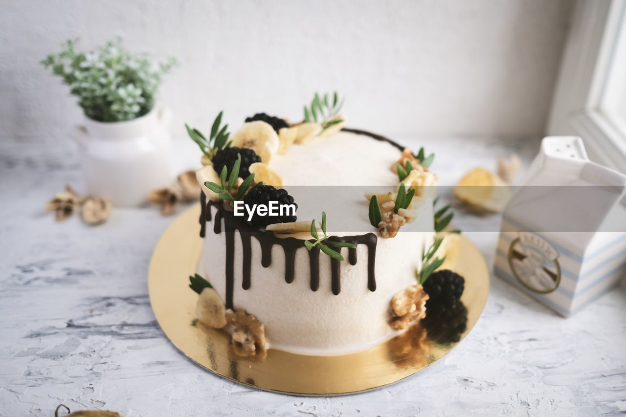 table, food and drink, indoors, freshness, still life, sweet food, food, indulgence, no people, close-up, sweet, text, western script, dessert, temptation, communication, ready-to-eat, baked, plant, high angle view