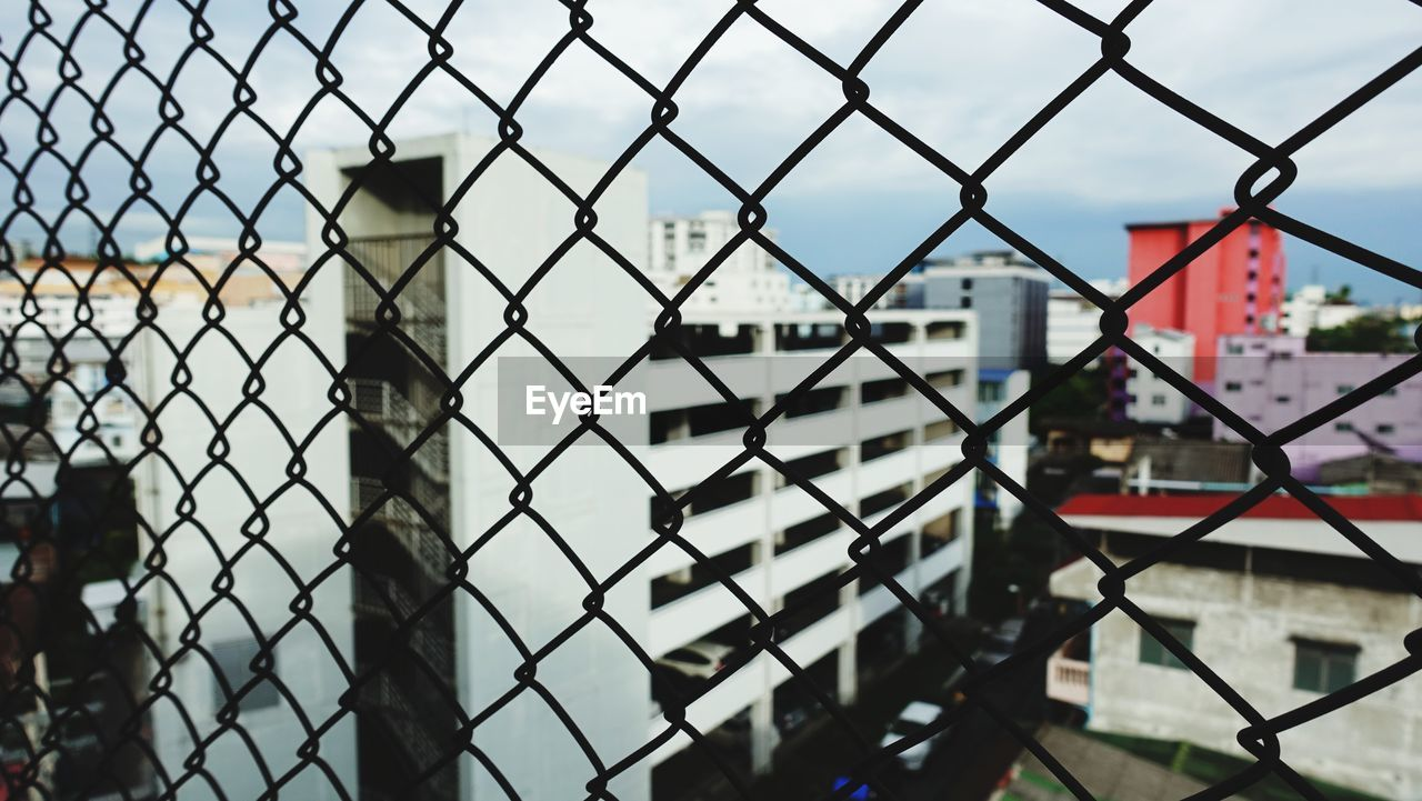 fence, boundary, barrier, security, protection, chainlink fence, safety, metal, focus on foreground, architecture, no people, day, building exterior, built structure, close-up, outdoors, nature, pattern, sky, building