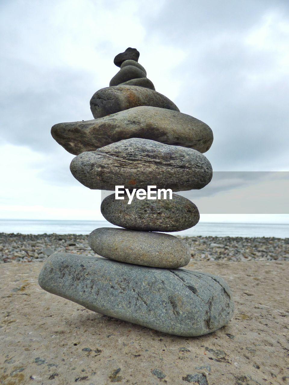 Close-up of pebbles stack at beach