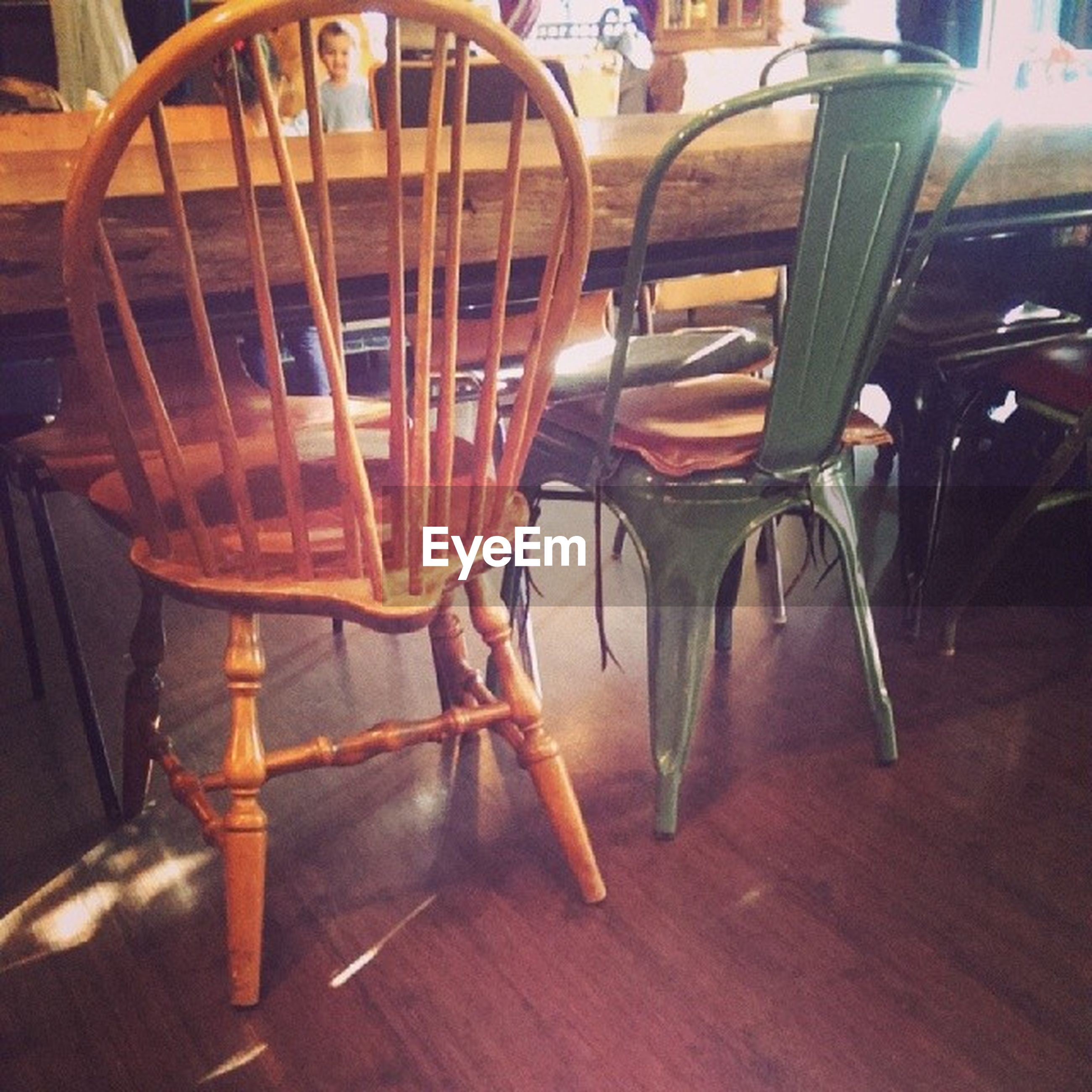 indoors, table, chair, wood - material, empty, absence, flooring, still life, no people, wooden, furniture, seat, close-up, wood, focus on foreground, shadow, in a row, animal themes, reflection, floor