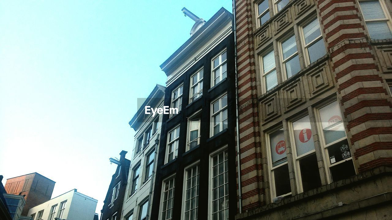 building exterior, architecture, built structure, low angle view, day, window, outdoors, no people, clear sky, city, sky