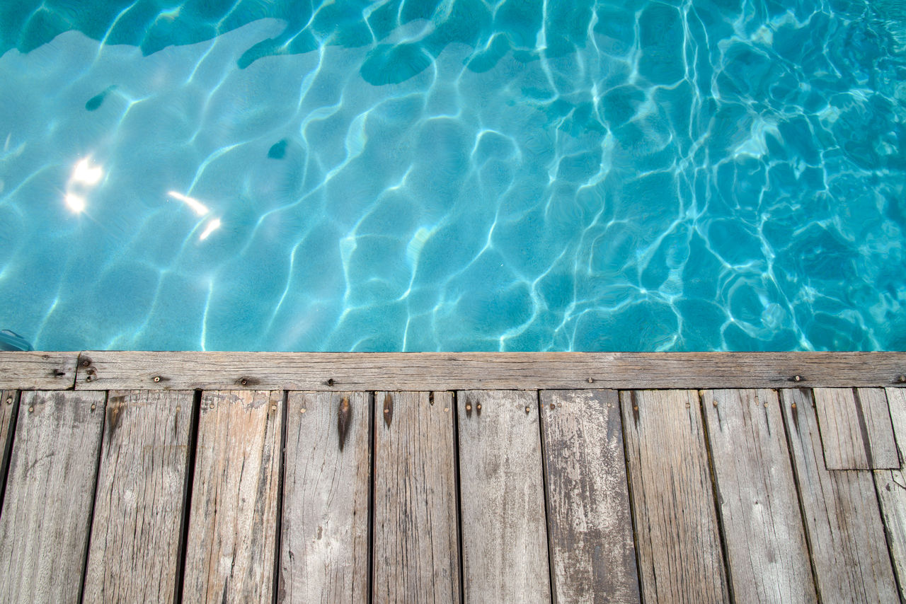 Wooden board on swimming pool