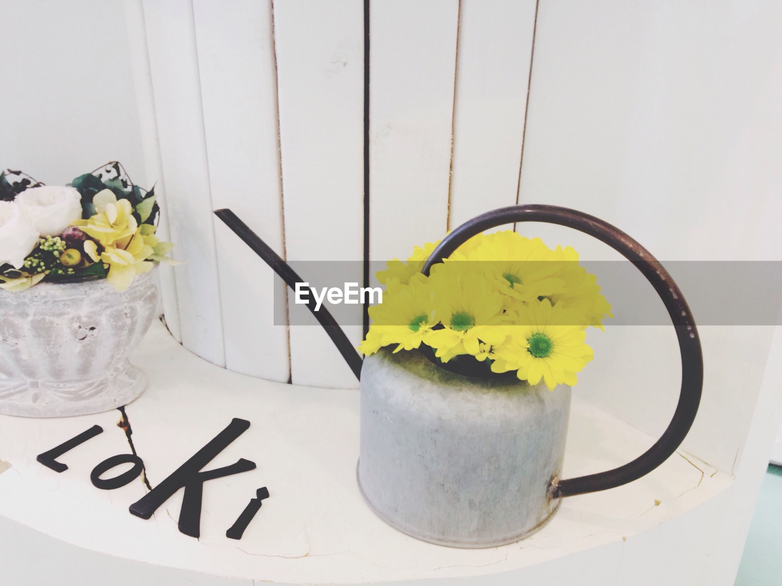 indoors, flower, yellow, freshness, vase, table, home interior, wall - building feature, white color, potted plant, still life, decoration, close-up, wall, creativity, fragility, plant, no people, petal, flower head