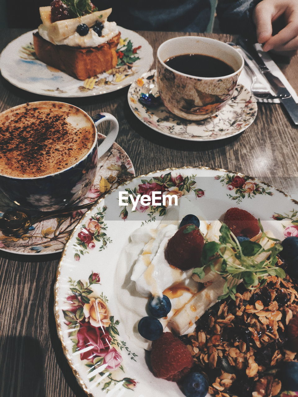 food and drink, food, freshness, human hand, table, hand, drink, cup, indoors, refreshment, mug, plate, ready-to-eat, human body part, tea, one person, hot drink, healthy eating, eating utensil, sweet, tea - hot drink, tea cup, temptation, crockery, meal, breakfast