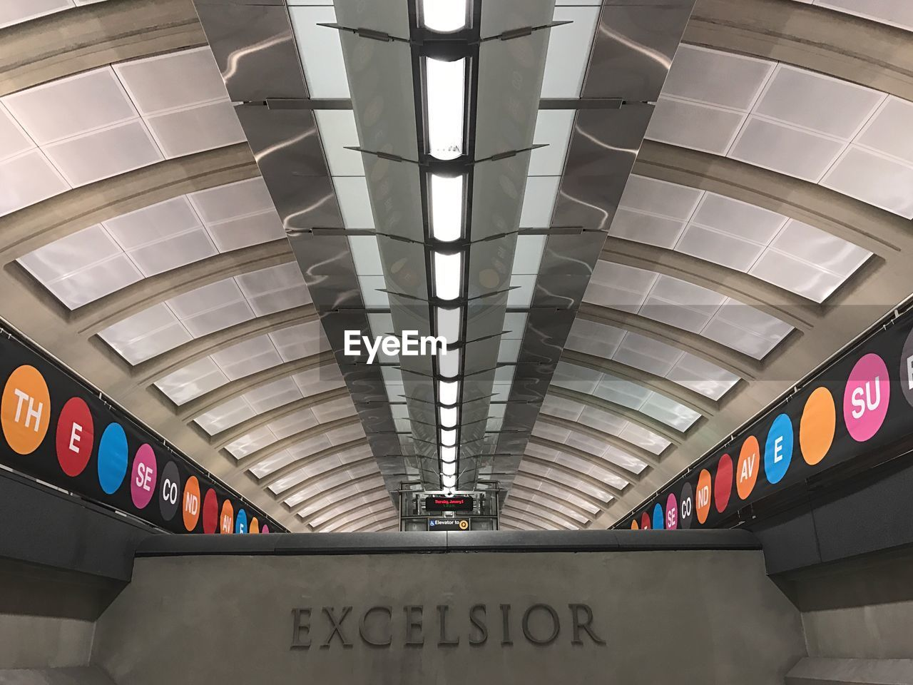 text, indoors, western script, architecture, communication, ceiling, built structure, transportation, modern, subway station, illuminated, transportation building - type of building, no people, day, city