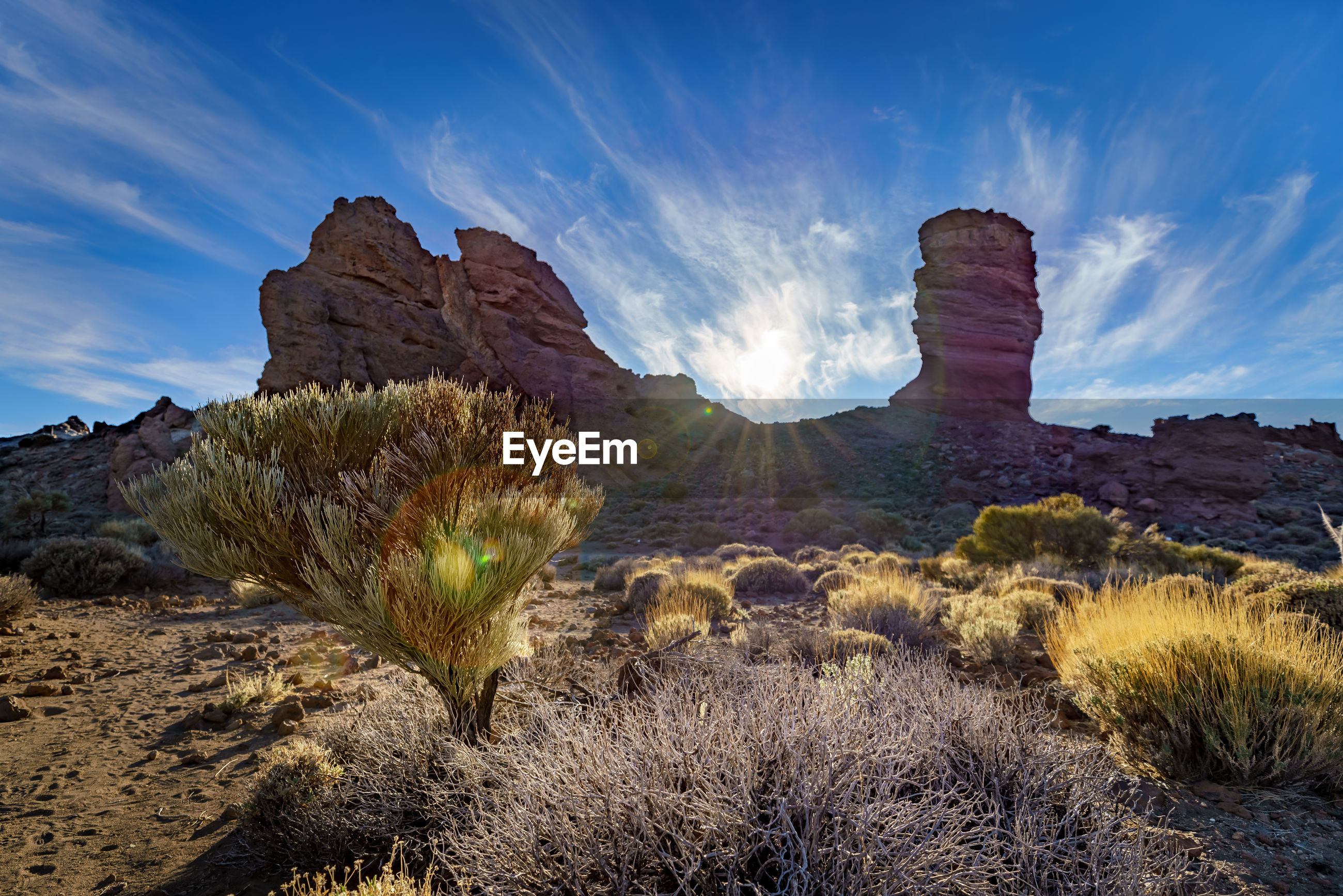 SCENIC VIEW OF ROCKS AGAINST SKY DURING SUNNY DAY