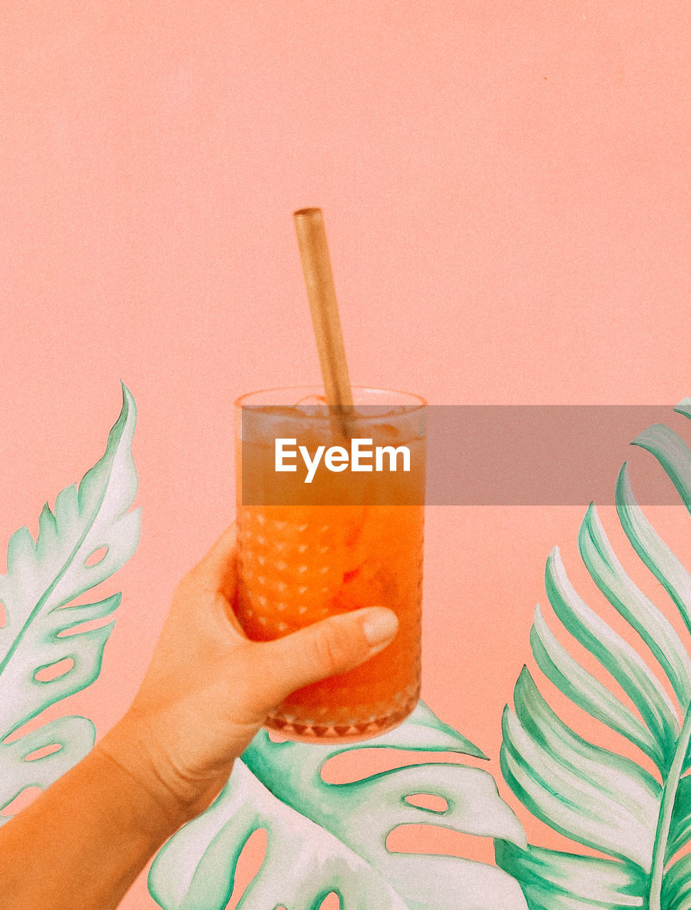 drink, refreshment, human hand, food and drink, straw, glass, drinking straw, hand, drinking glass, household equipment, holding, human body part, lifestyles, indoors, food, real people, one person, body part, freshness, cocktail, finger, non-alcoholic beverage, human limb