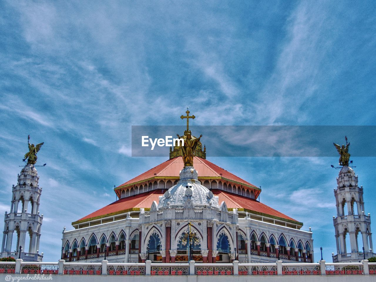 architecture, built structure, building exterior, sky, cloud - sky, building, travel destinations, religion, belief, place of worship, nature, art and craft, spirituality, travel, human representation, representation, low angle view, the past, history, no people, outdoors, ornate