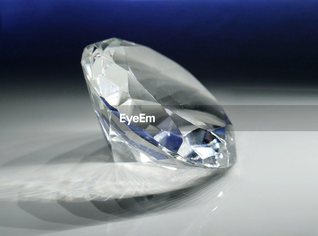 luxury, wealth, jewelry, gemstone, close-up, crystal, shiny, precious gem, shape, single object, studio shot, no people, reflection, black background, indoors, white background
