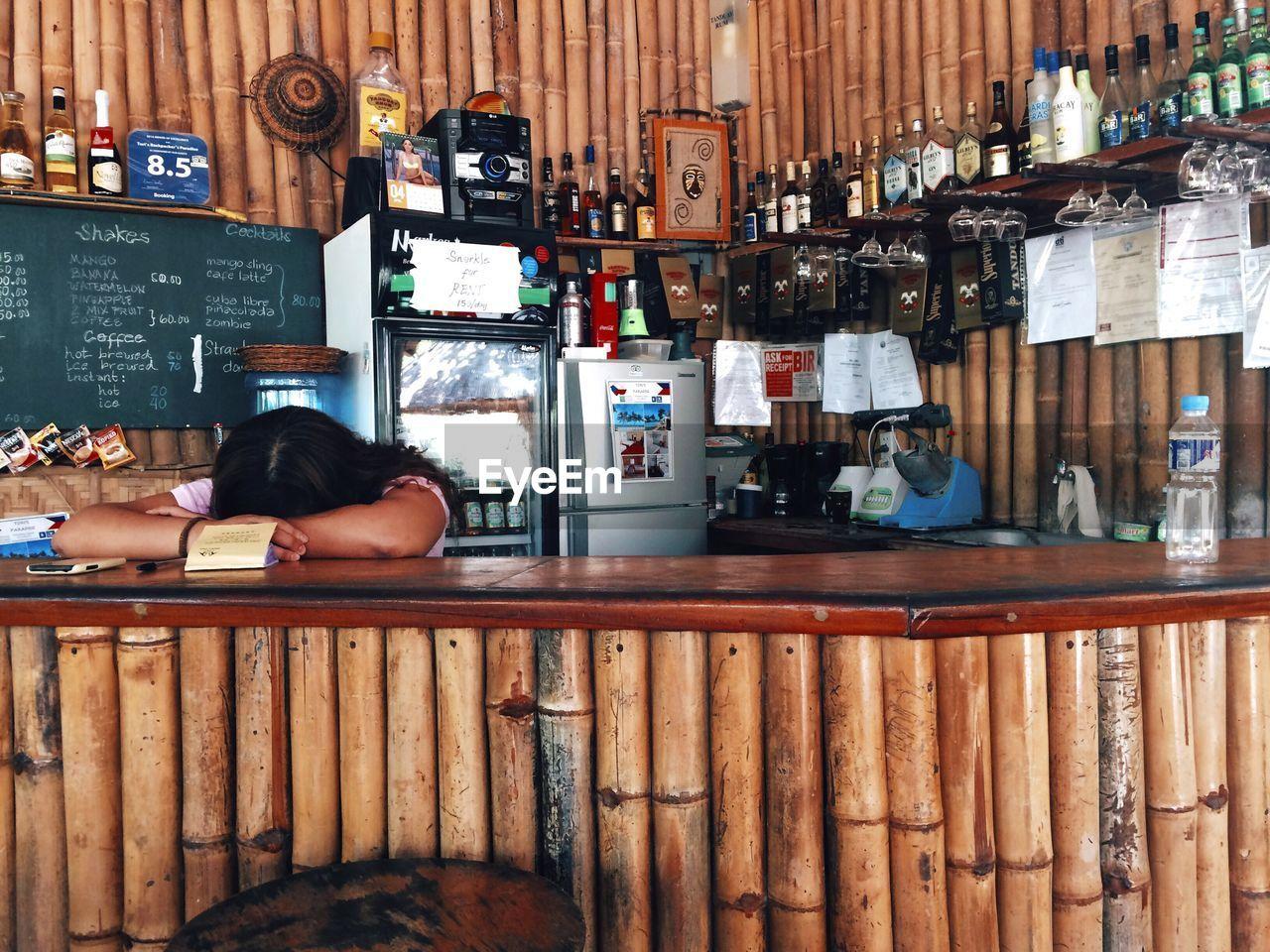 Woman Sleeping At Bar Counter