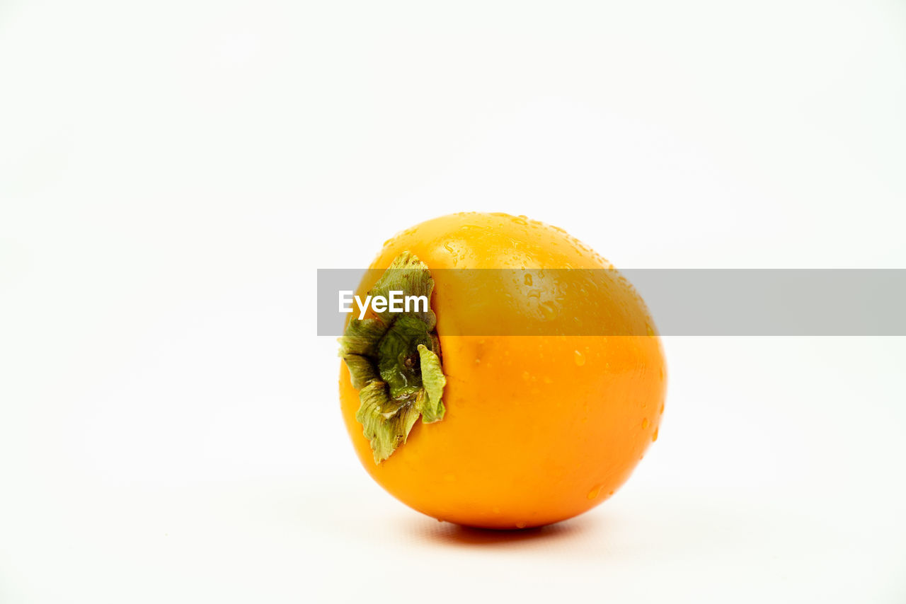 studio shot, healthy eating, white background, food and drink, food, wellbeing, single object, freshness, copy space, indoors, still life, fruit, close-up, cut out, orange color, no people, vegetable, yellow, citrus fruit, orange