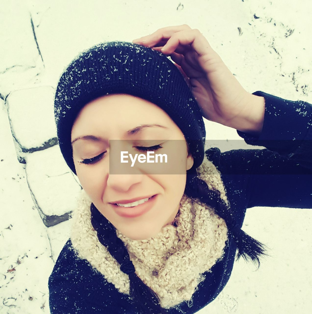 High Angle View Of Woman With Eyes Closed Wearing Knit Hat During Winter