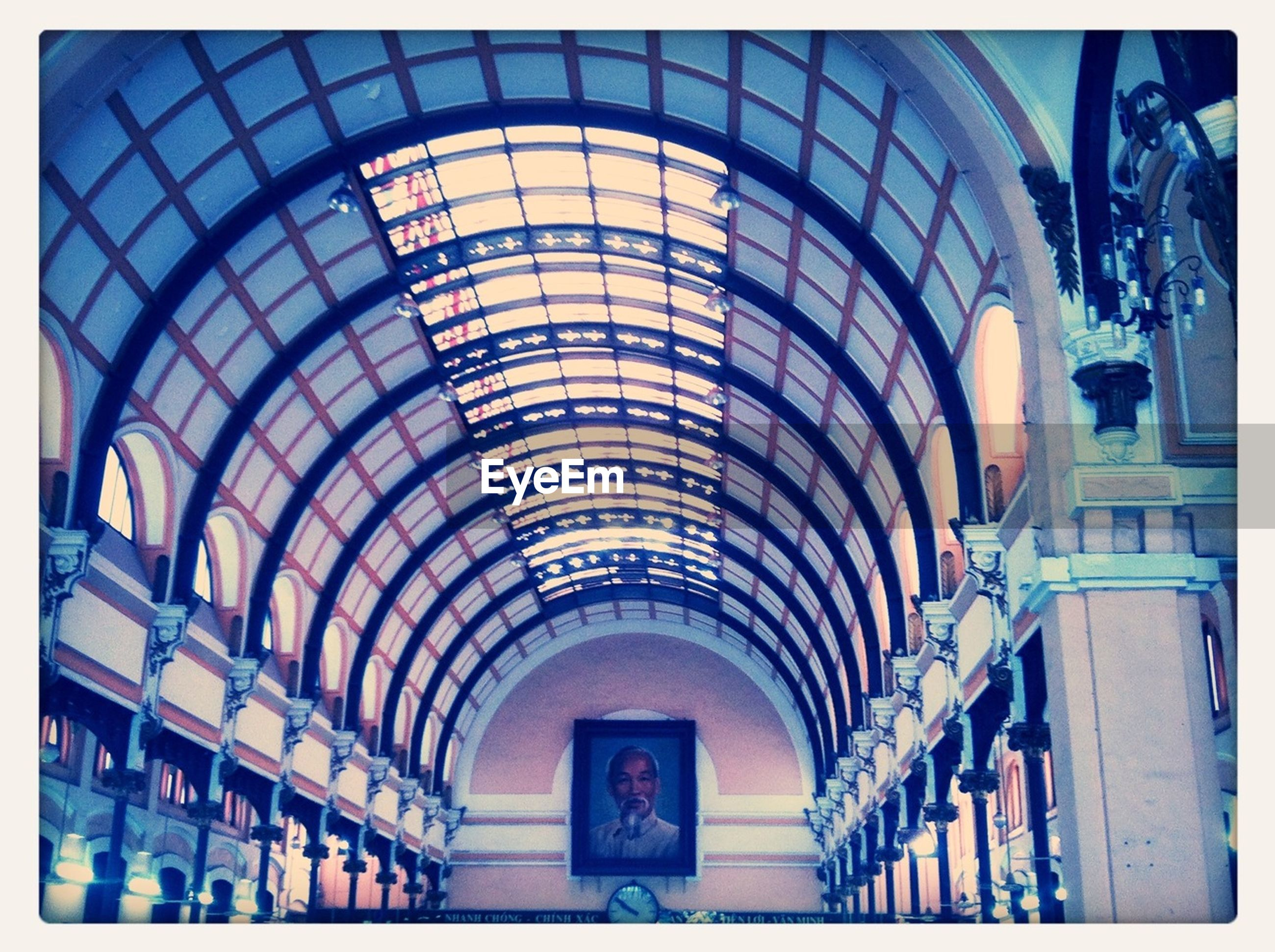 arch, indoors, ceiling, architecture, human representation, built structure, low angle view, sculpture, day, no people