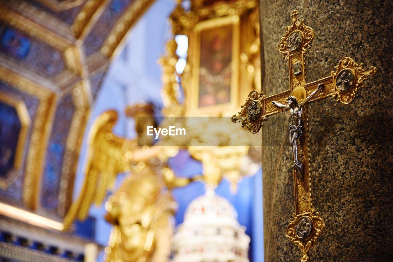Close-up of cross in church