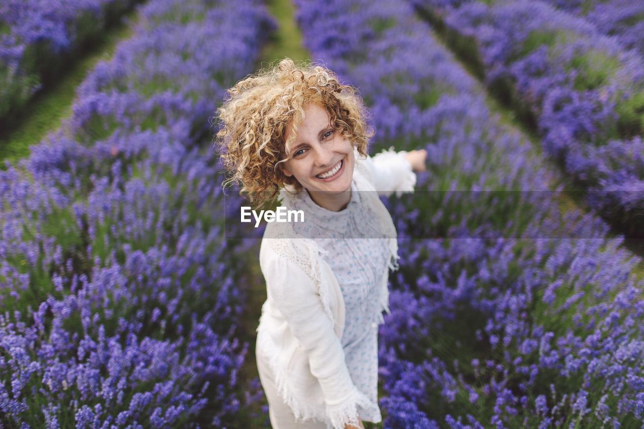 Portrait Of Woman Enjoying On Lavender Field