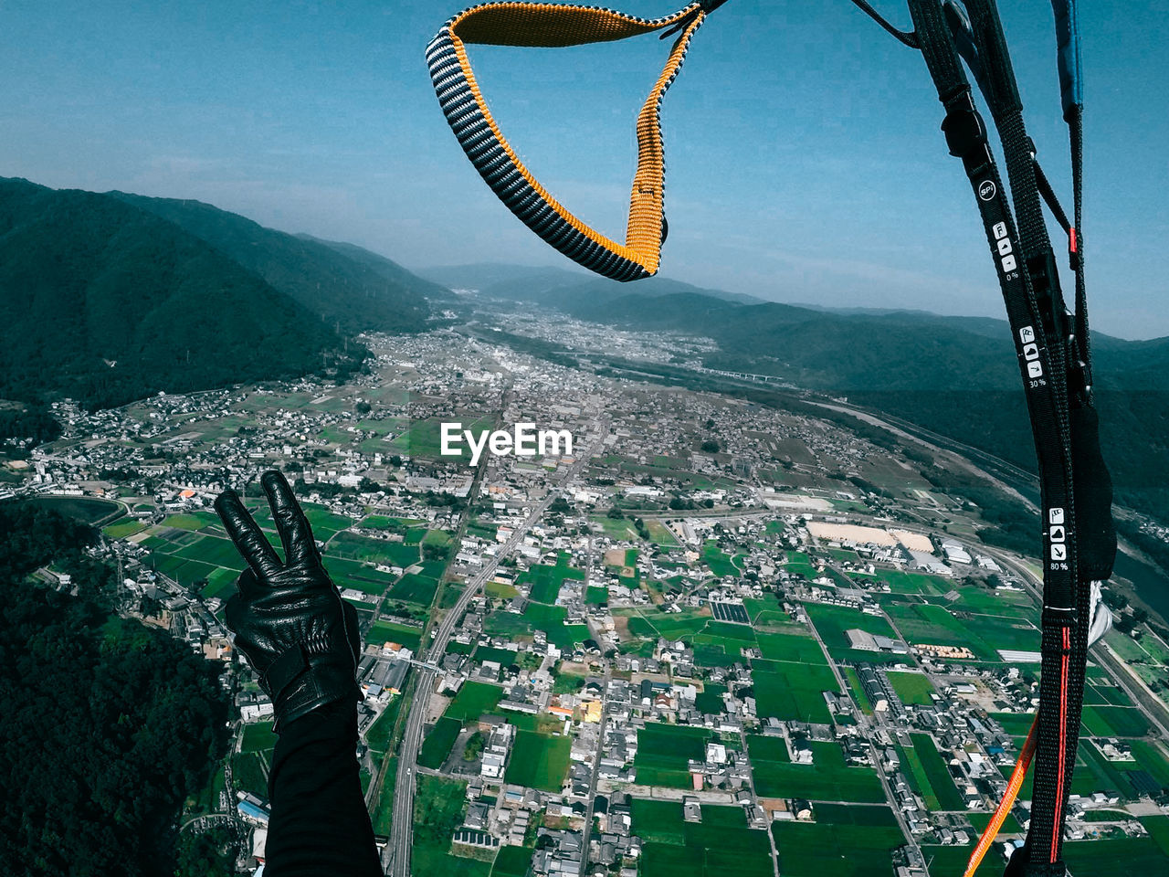Person Paragliding Above City