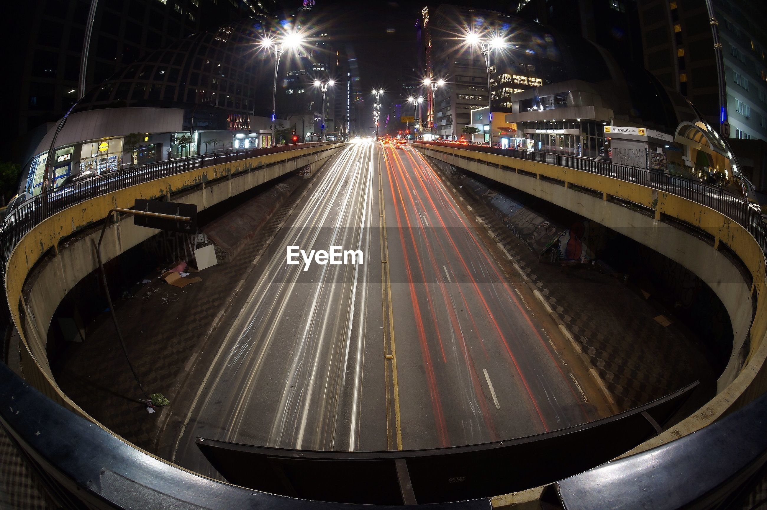 Circular bridge over multiple lane highway in city