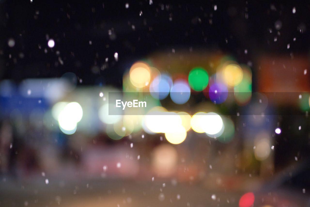 illuminated, night, focus on foreground, defocused, no people, outdoors, close-up, nature