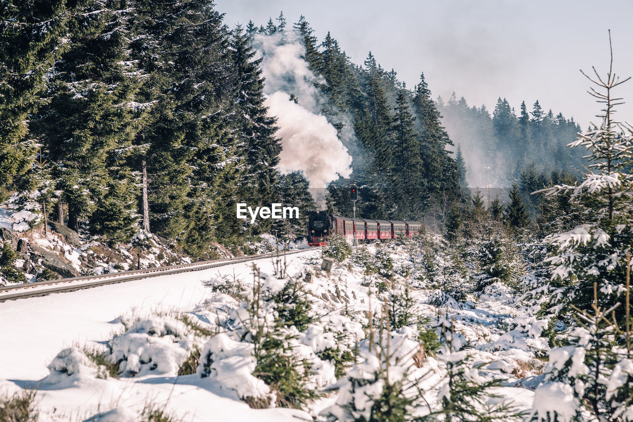 Steam Train On Railroad Tracks During Winter