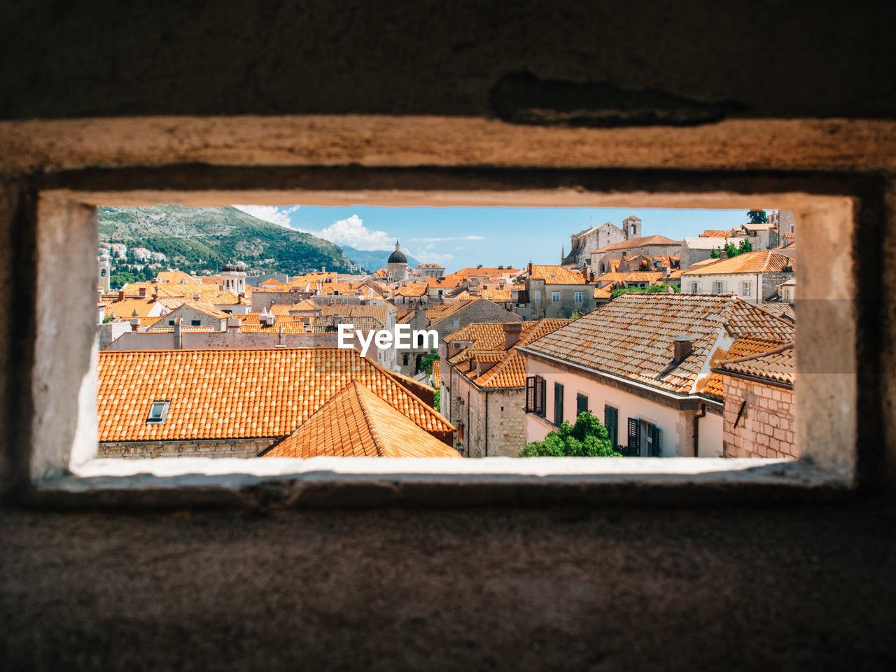 Residential Buildings In Town As Seen Through Window