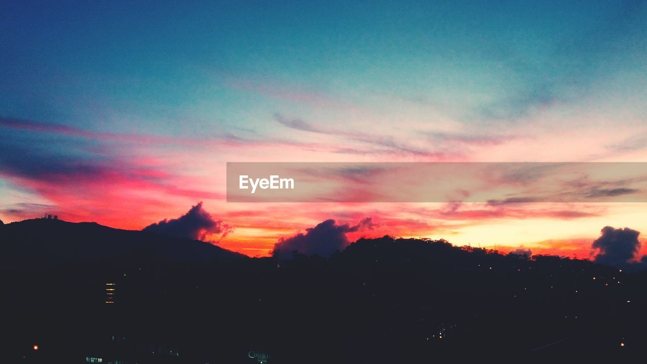 Scenic view of silhouette landscape against sky at dusk