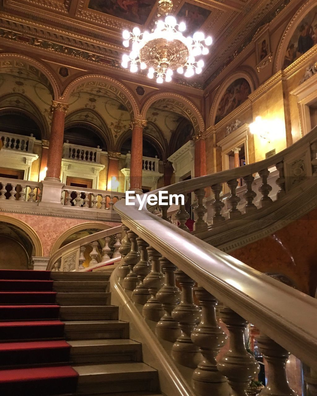 illuminated, indoors, railing, staircase, architecture, ornate, steps, steps and staircases, architectural column, real people, day