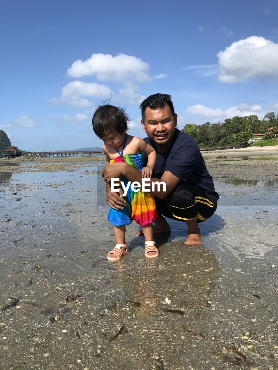 childhood, child, males, two people, togetherness, men, sky, full length, family, real people, water, boys, bonding, cloud - sky, beach, leisure activity, emotion, casual clothing, positive emotion, innocence, son