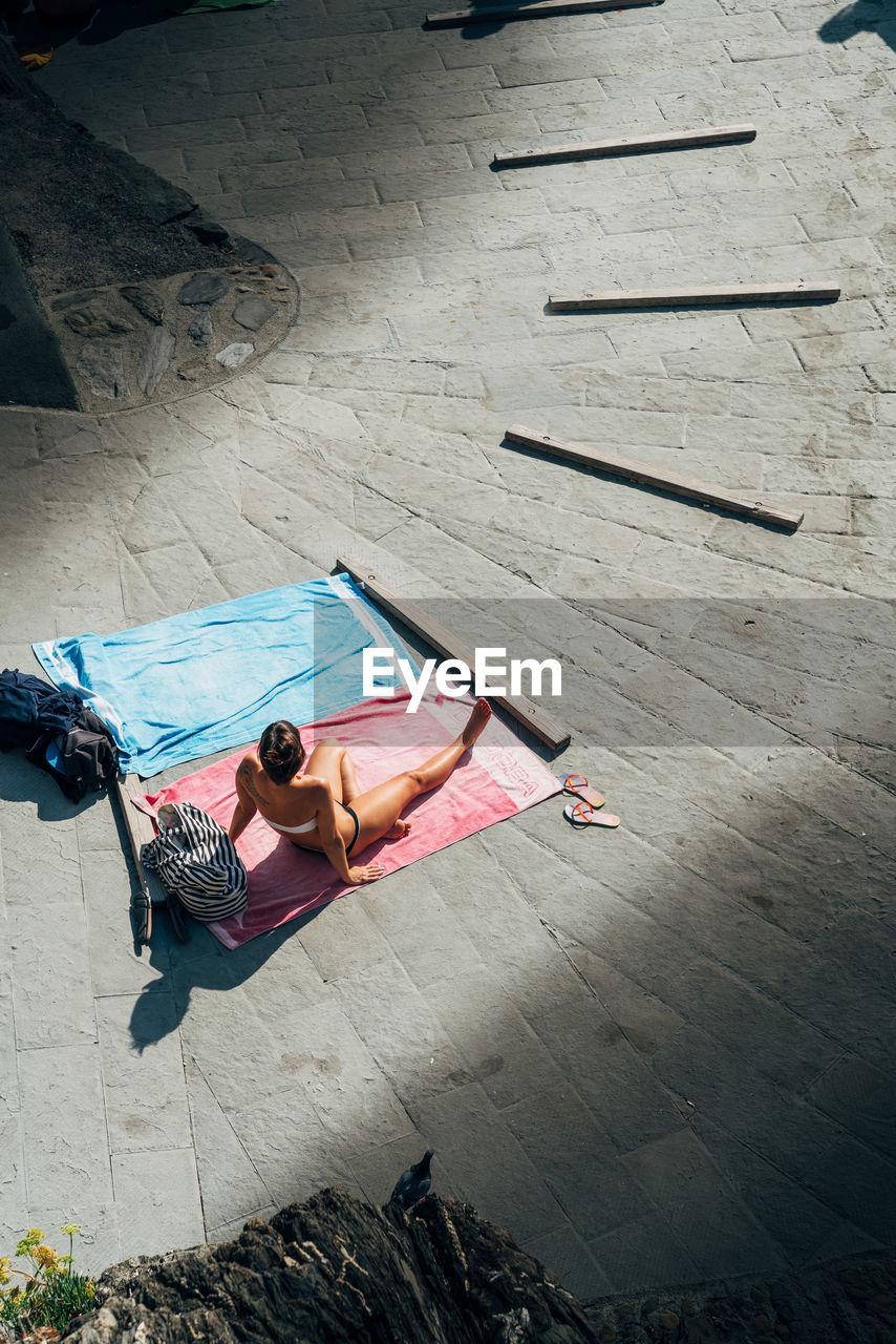 High Angle View Of Woman Sunbathing
