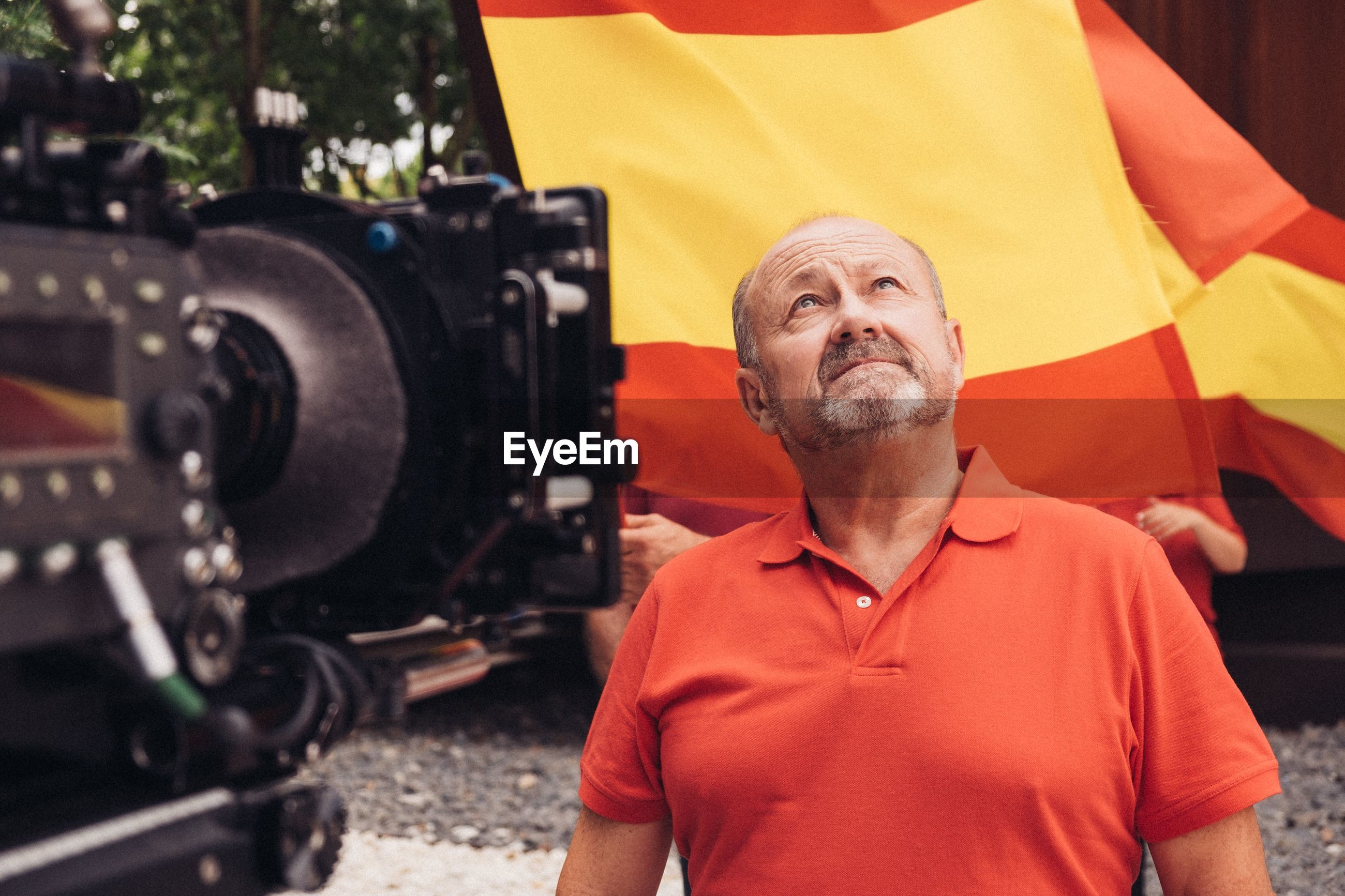 Man looking up against spanish flag
